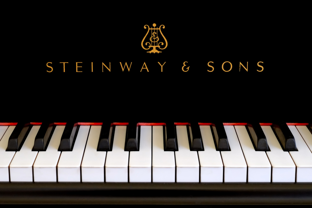 Steinway-Sons-logo-close-up.-Classic-gold-lettering-above-the-piano-keys-of-a-ebony-black-Steinway-grand-piano-1.jpg