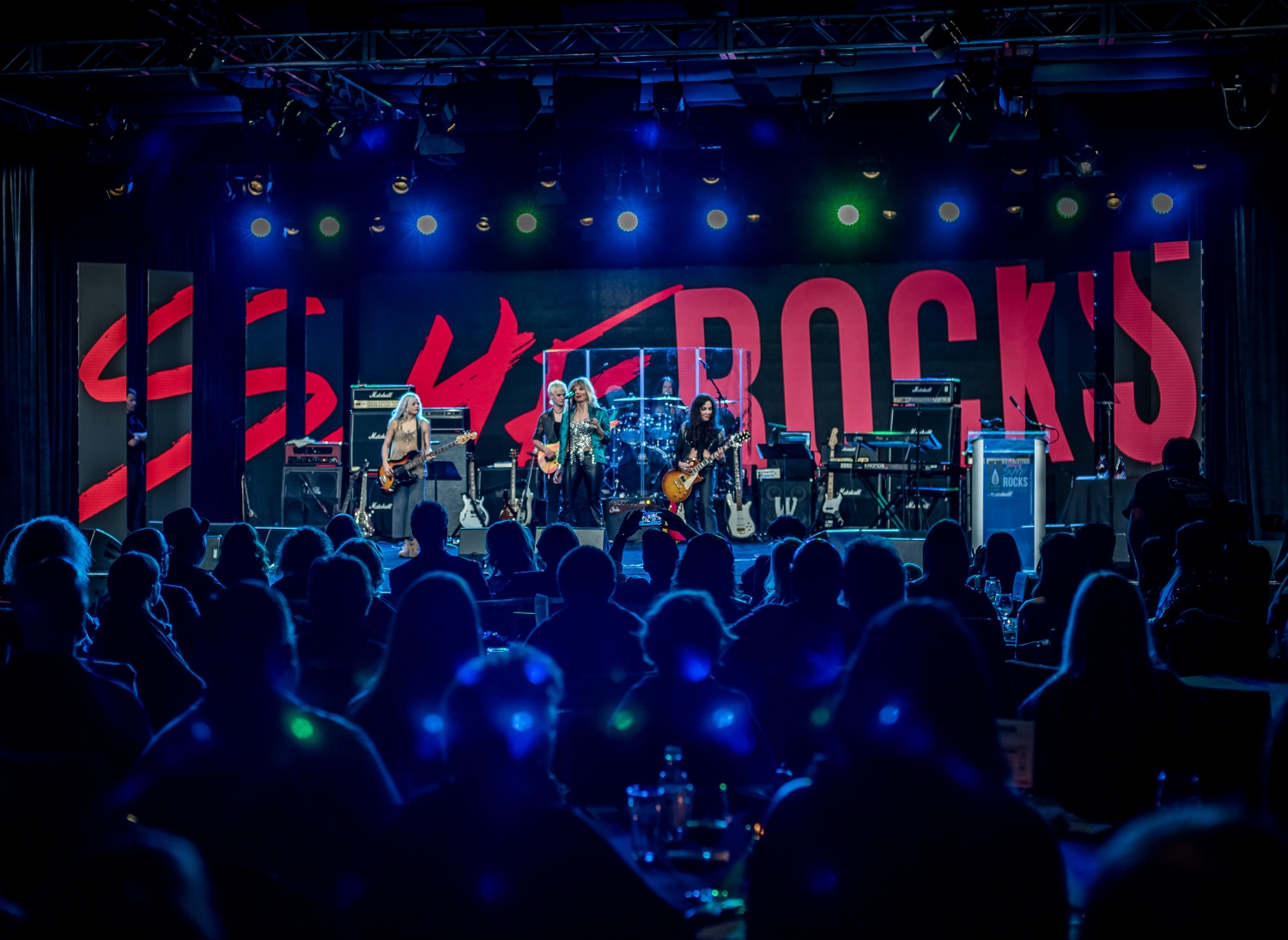 Marlain Angelides with Lez Zeppelin on she Rocks stage