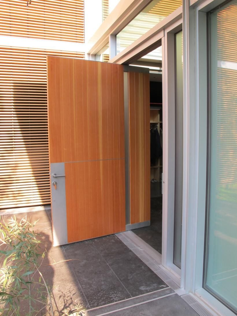 Wood pivot door, aluminum details
