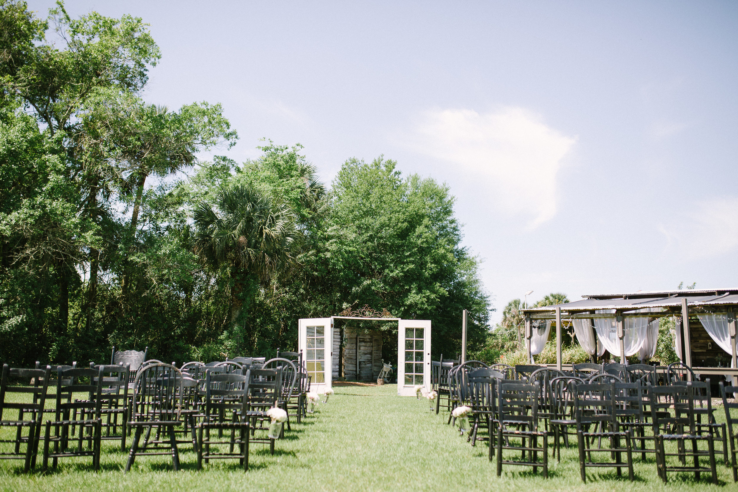 Loved this country setting with the old french doors and mismatched farm chairs!