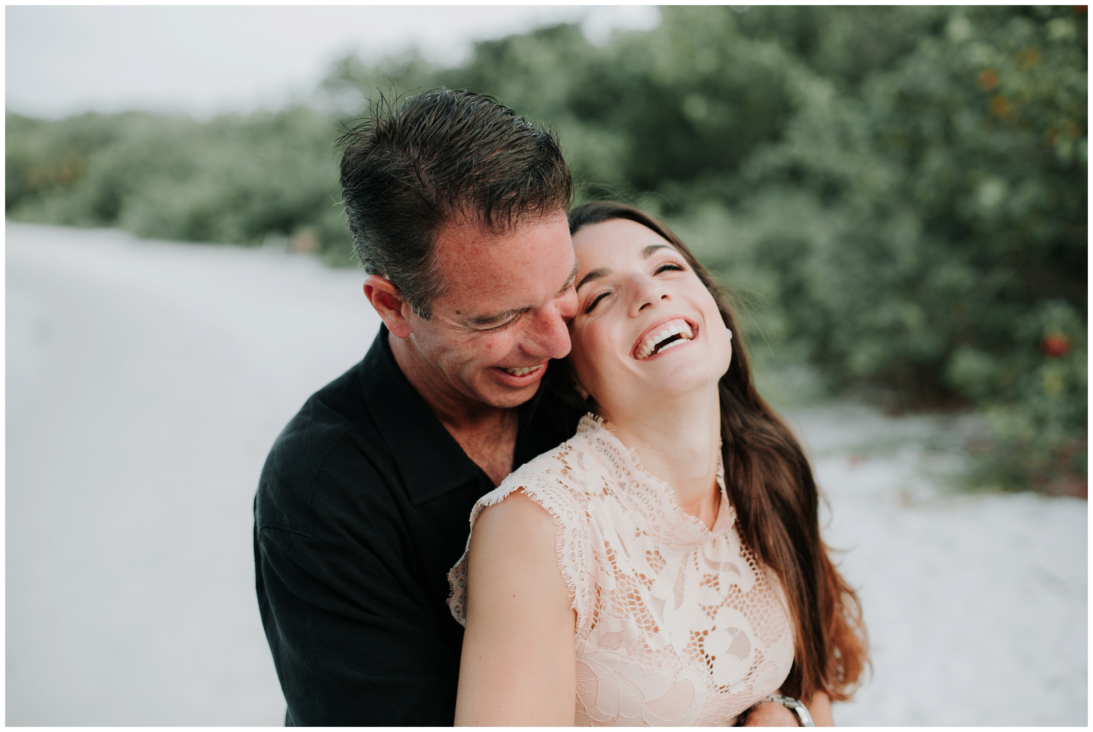 Engaged couple sharing a laugh during their session in Jupiter Florida