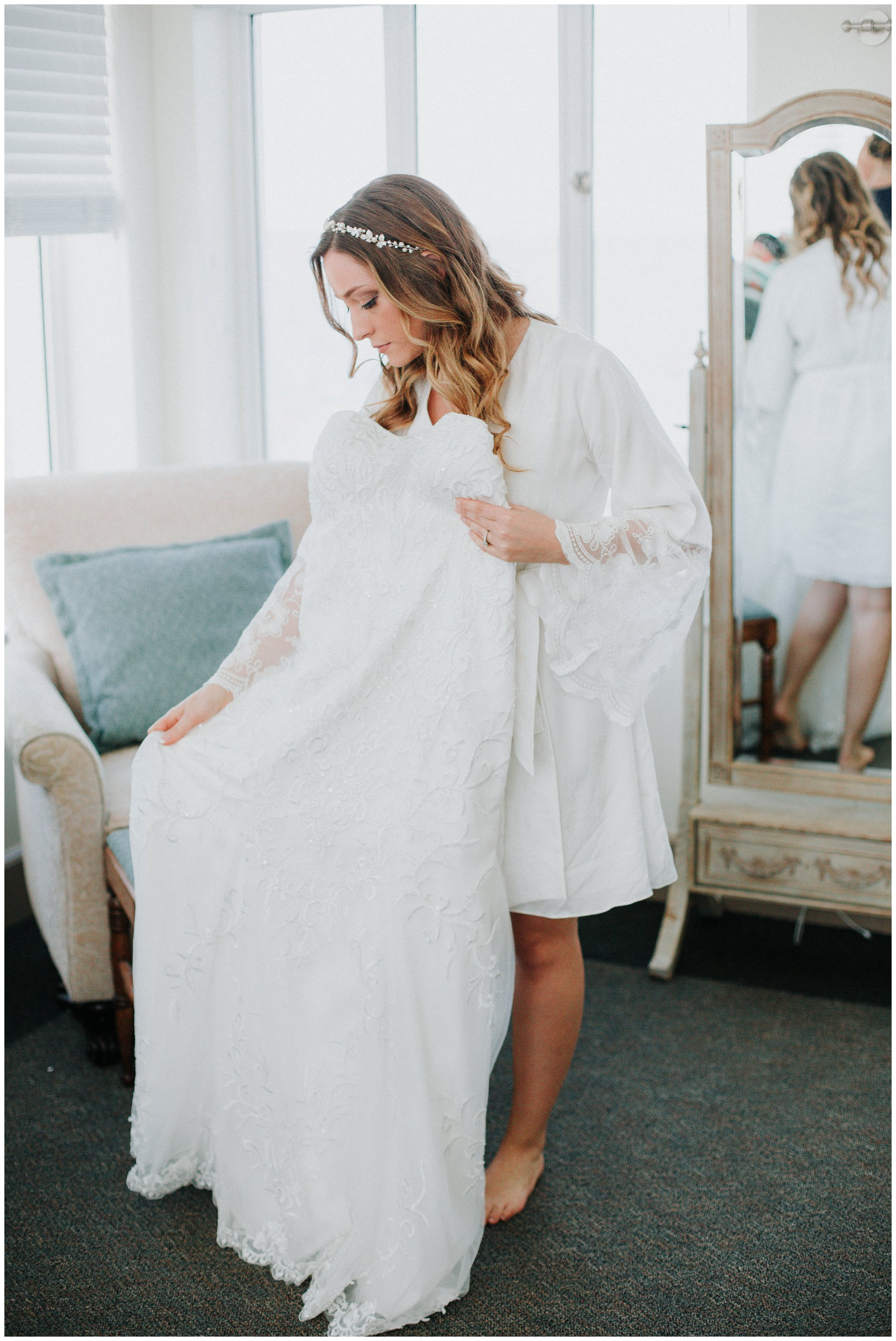I loved her gorgeous wedding gown. It was perfect for the coastal setting.