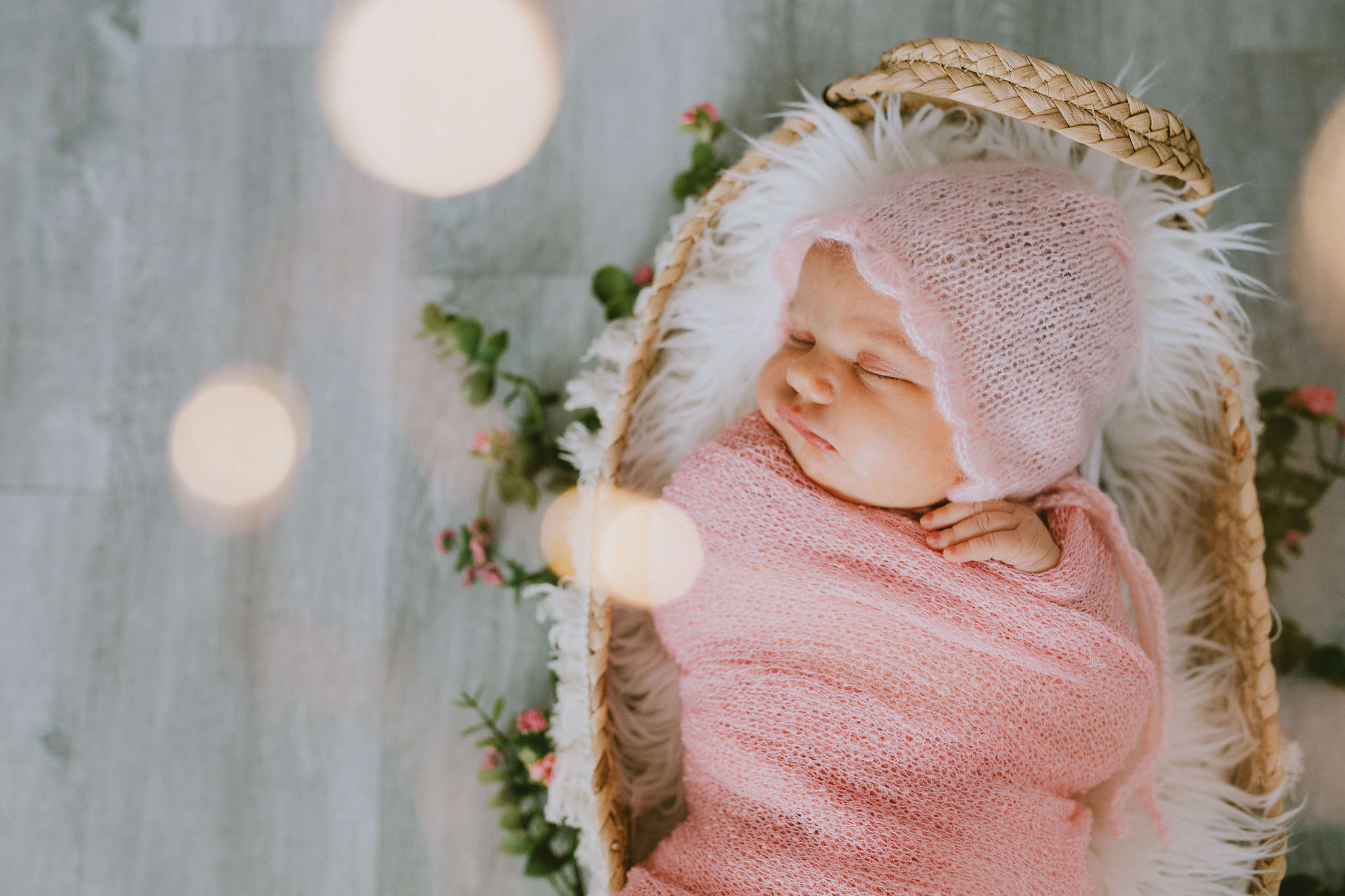 Baby girl in pink swaddle