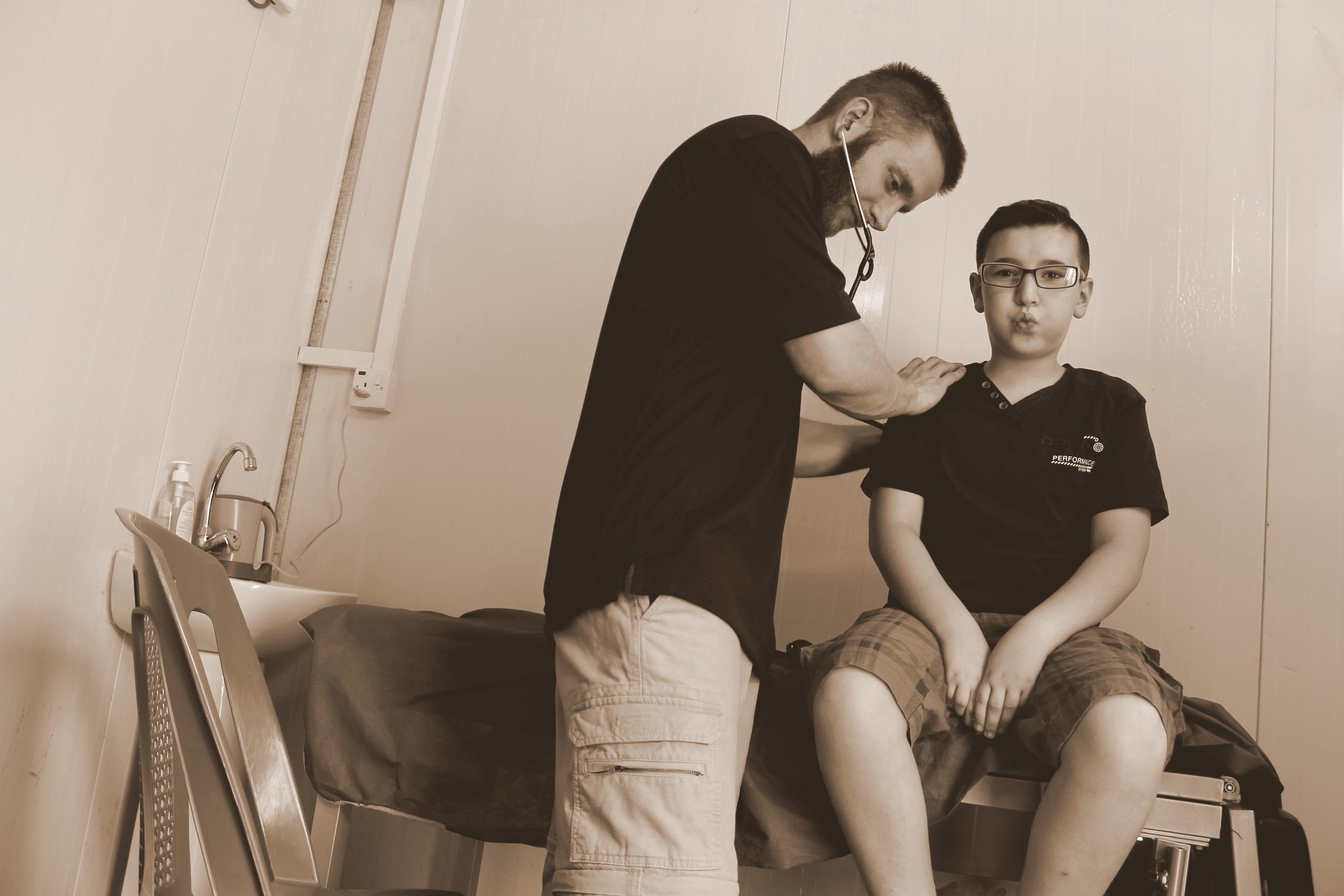 GSMSG medical team members providing basic physical exams