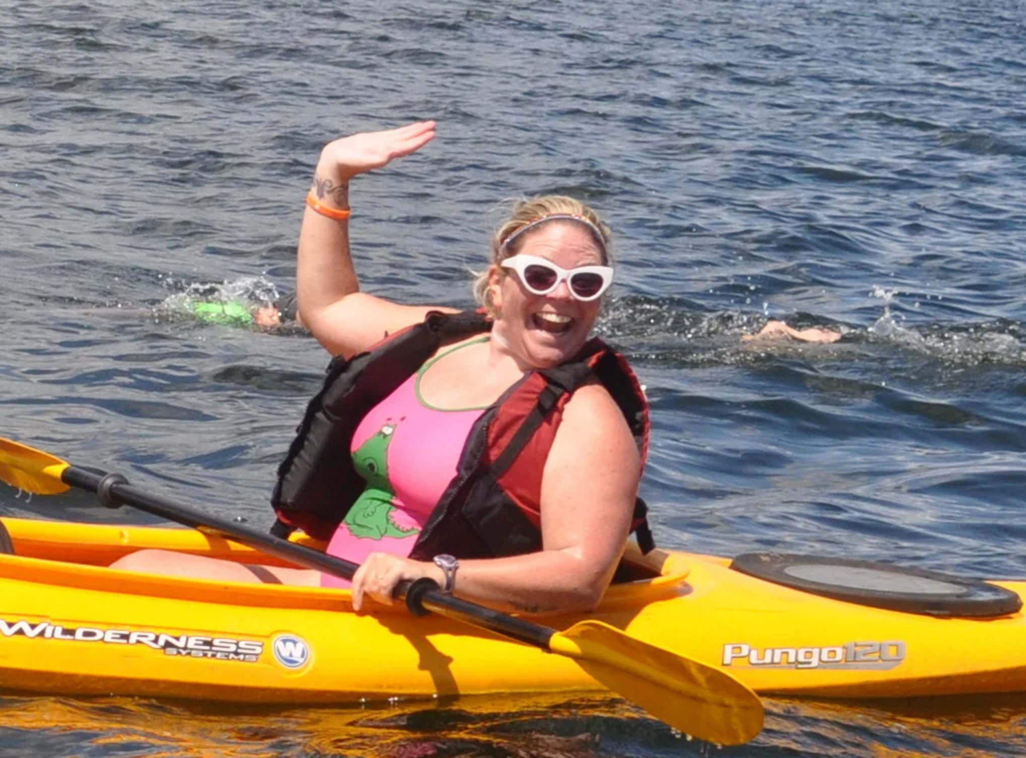 New Englander Elaine Howley provides kayak support during the 10 mile race