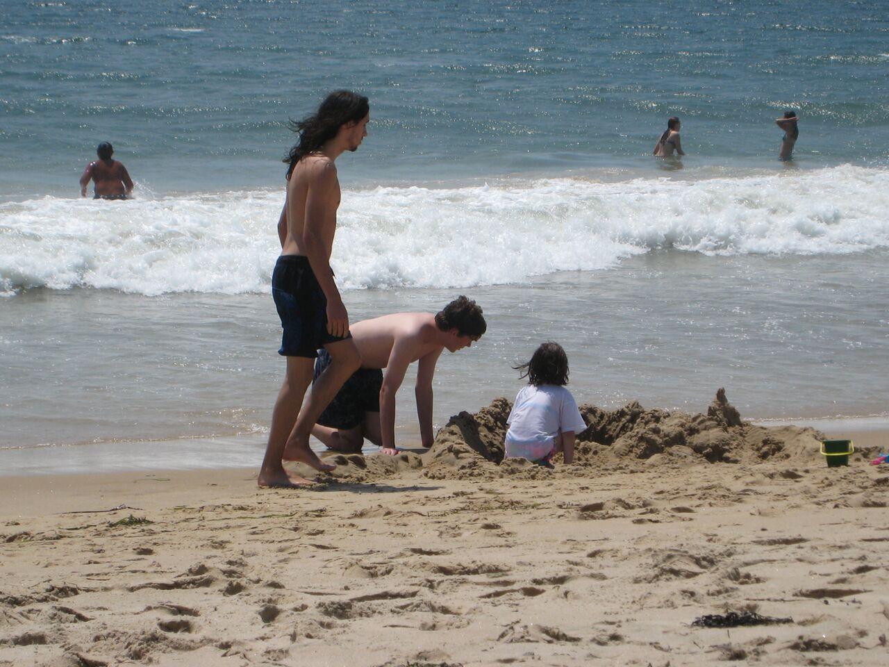 The Simpson children enjoy the sandy beach