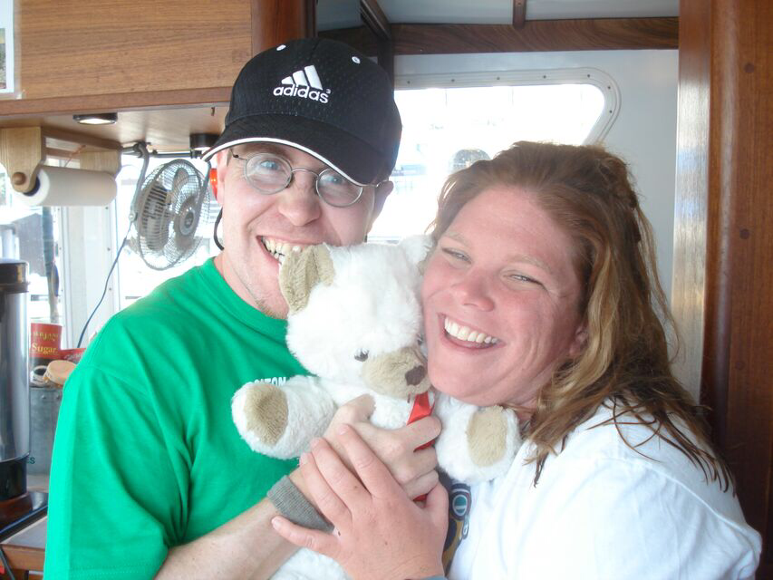 Howley with her husband, Mark, and Mr. Bear after she finished Catalina Channel, her first major channel swim, in 2008.  Read more about Mr. Bear here.