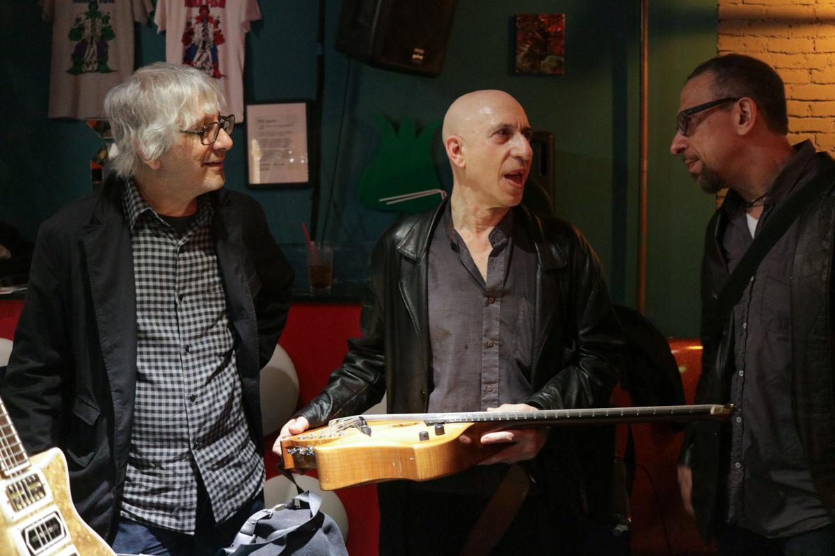 Lee Ranaldo and Joel Harrison checking out Elliott Sharp's Koll RE 8-string.