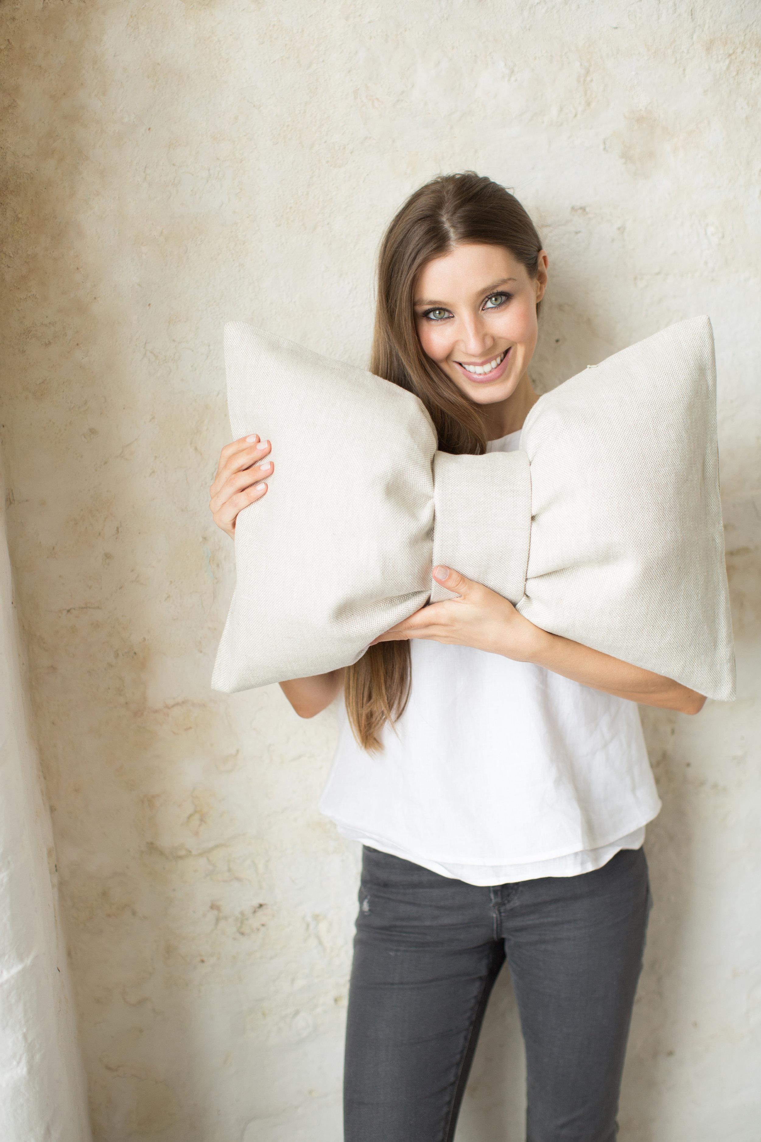 Irish Designer-Maker Katie Larmour of Katie Larmour Design, Luxury Irish Linen Brand, Award winning signature 'Bow' cushion photographed at Conway Mill Belfast.jpg