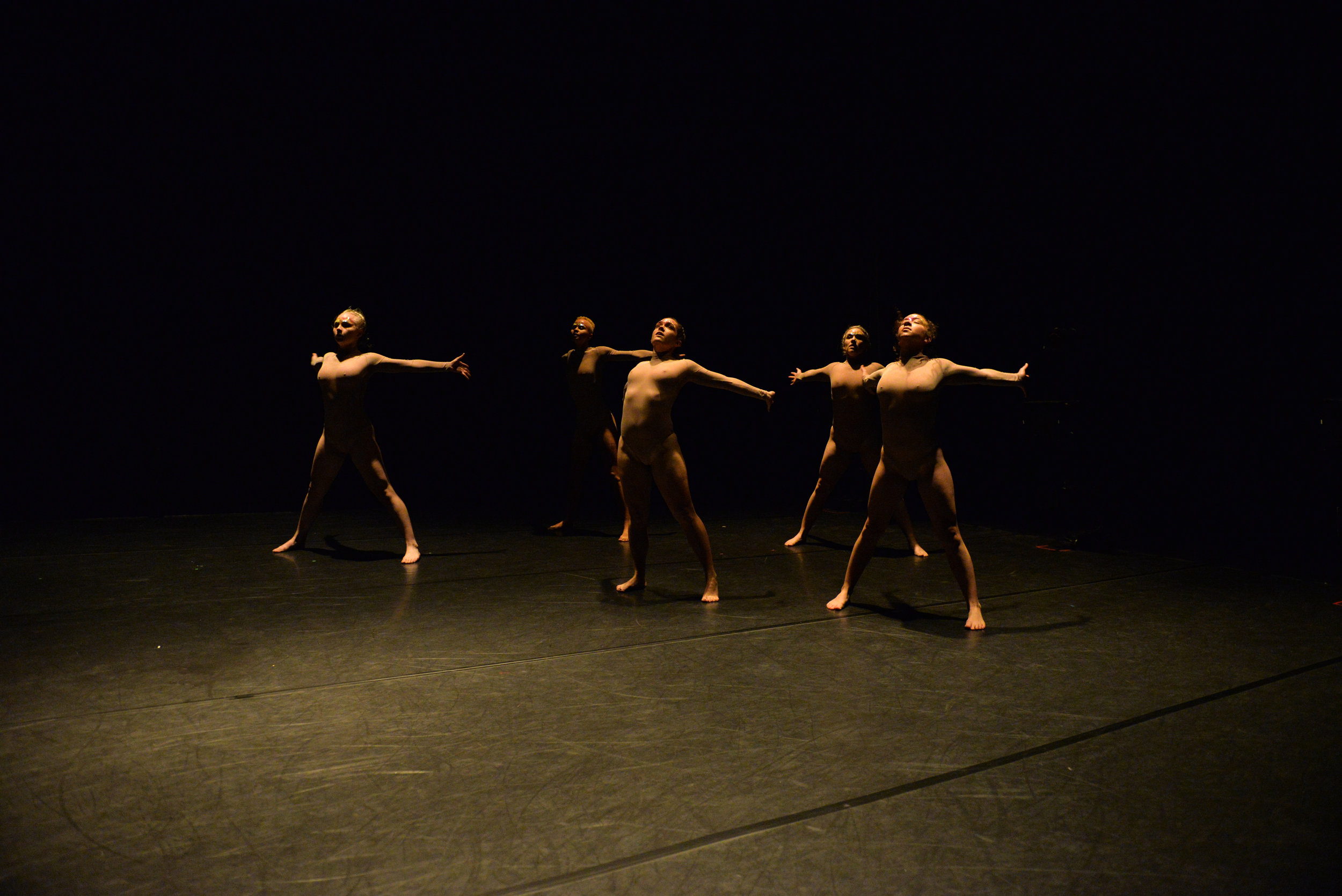 Photo of five dancers with arms wide, standing up. Photo by Jessica Schmitt from the 11th Annual REVERBDance Festival.