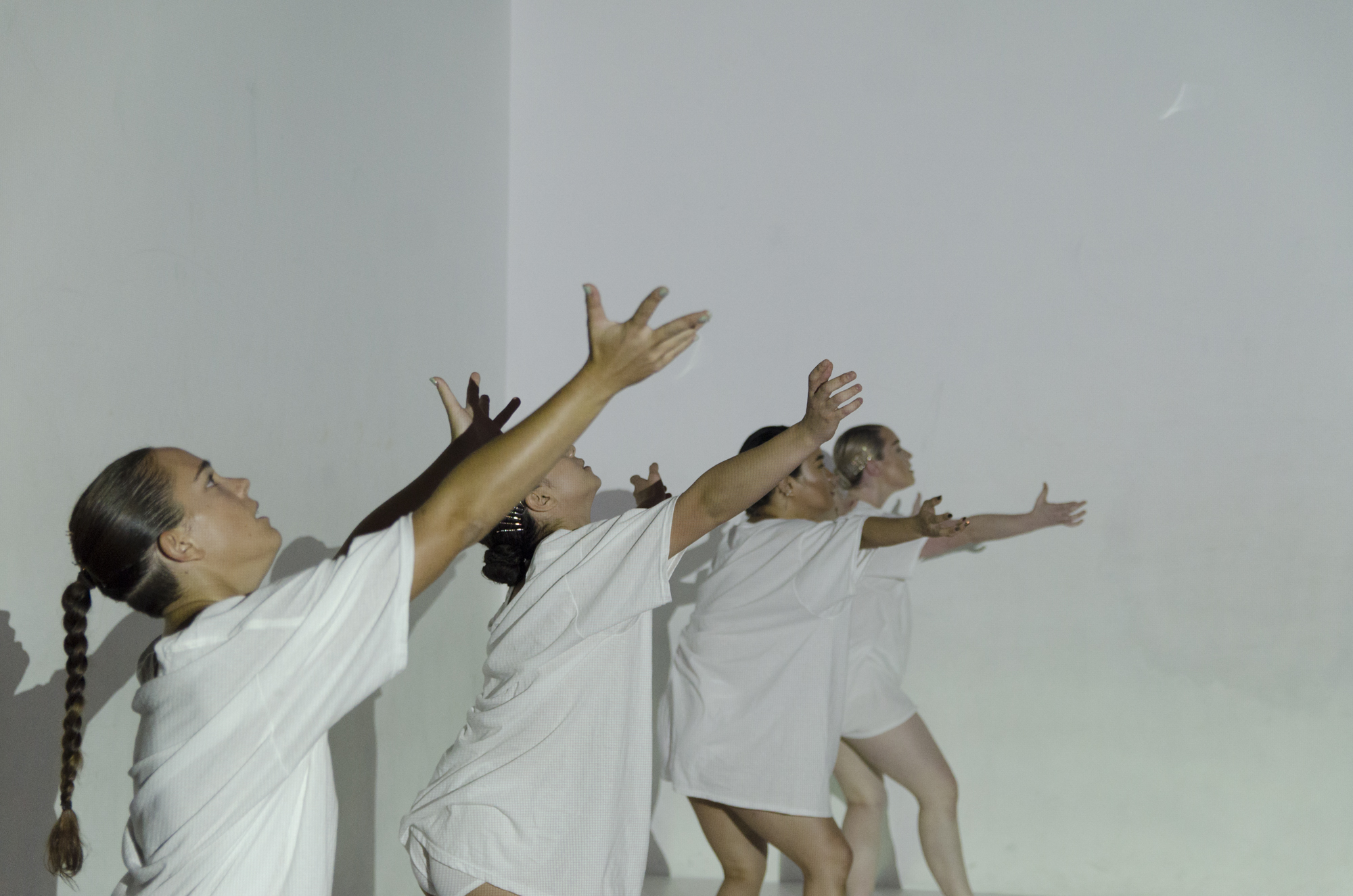 Four dancers with arms wide in a row, photo by Umi Akiyoshi. Photo from DOC Series in October 2017.