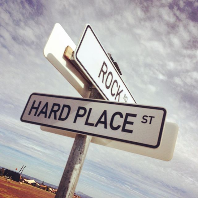 Decision decisions...hahah!  Flashback to Afrika Burn. . . #stuckbetweenarockandahardplace #streetsign #direction #desert #afrikaburn #decisionsdecisions