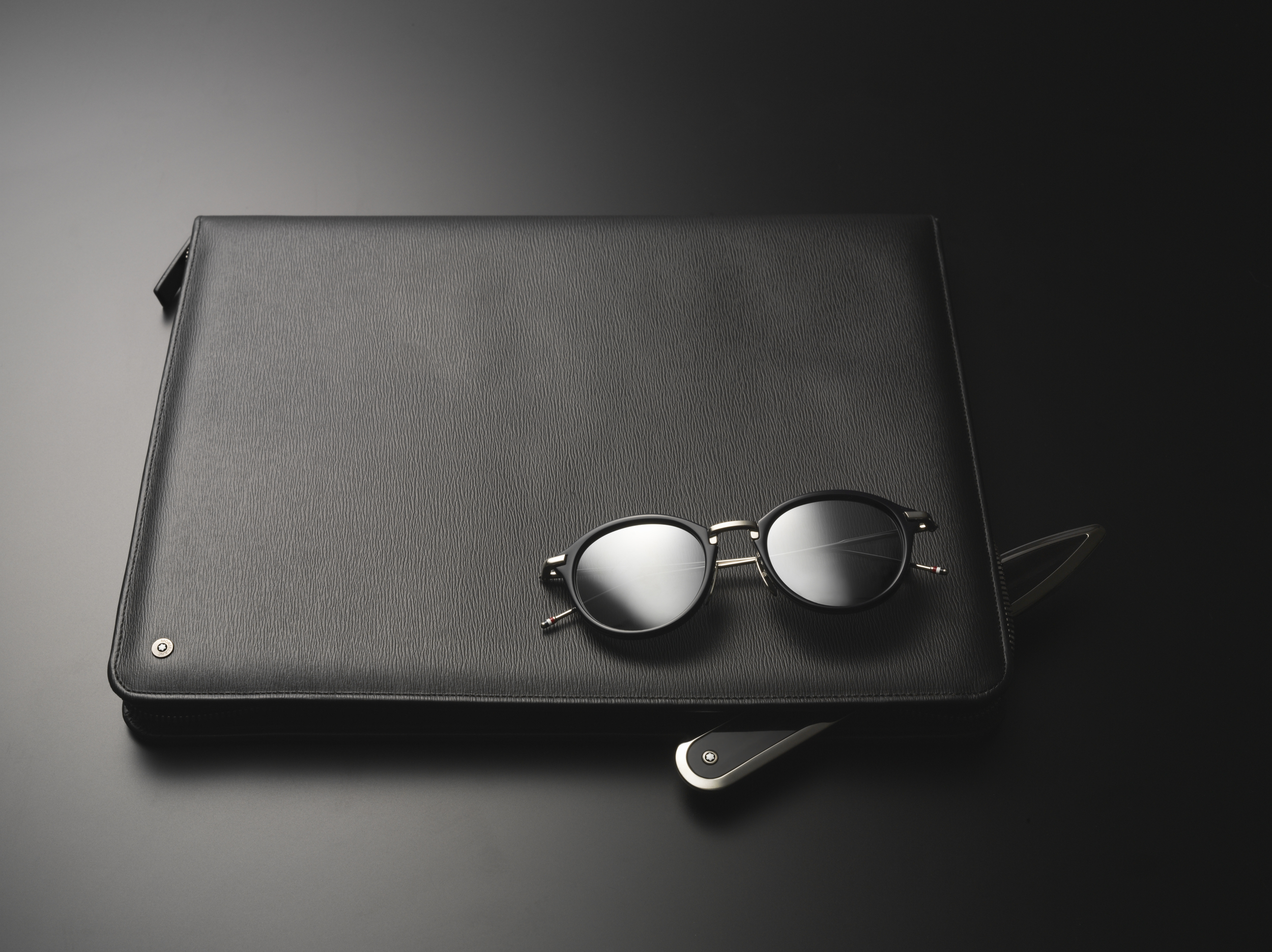 Mont Blanc  leather briefcase and letter opener,  Thom Browne  sunglasses