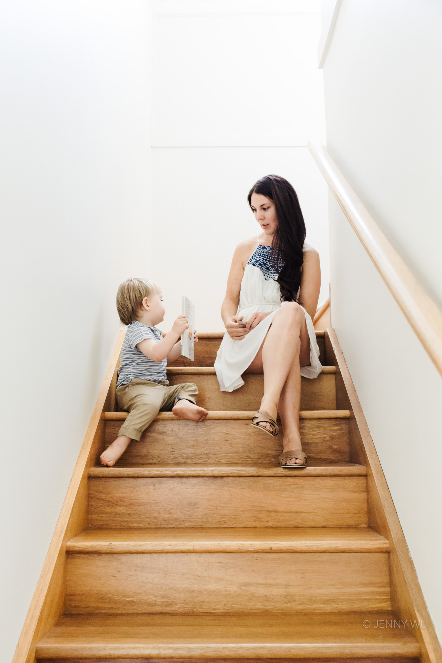 natural light portrait baby and mother wooden staircase
