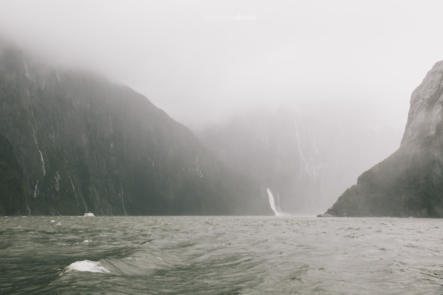 Rain, fog, and waterfalls in Milford Sounds New Zealand