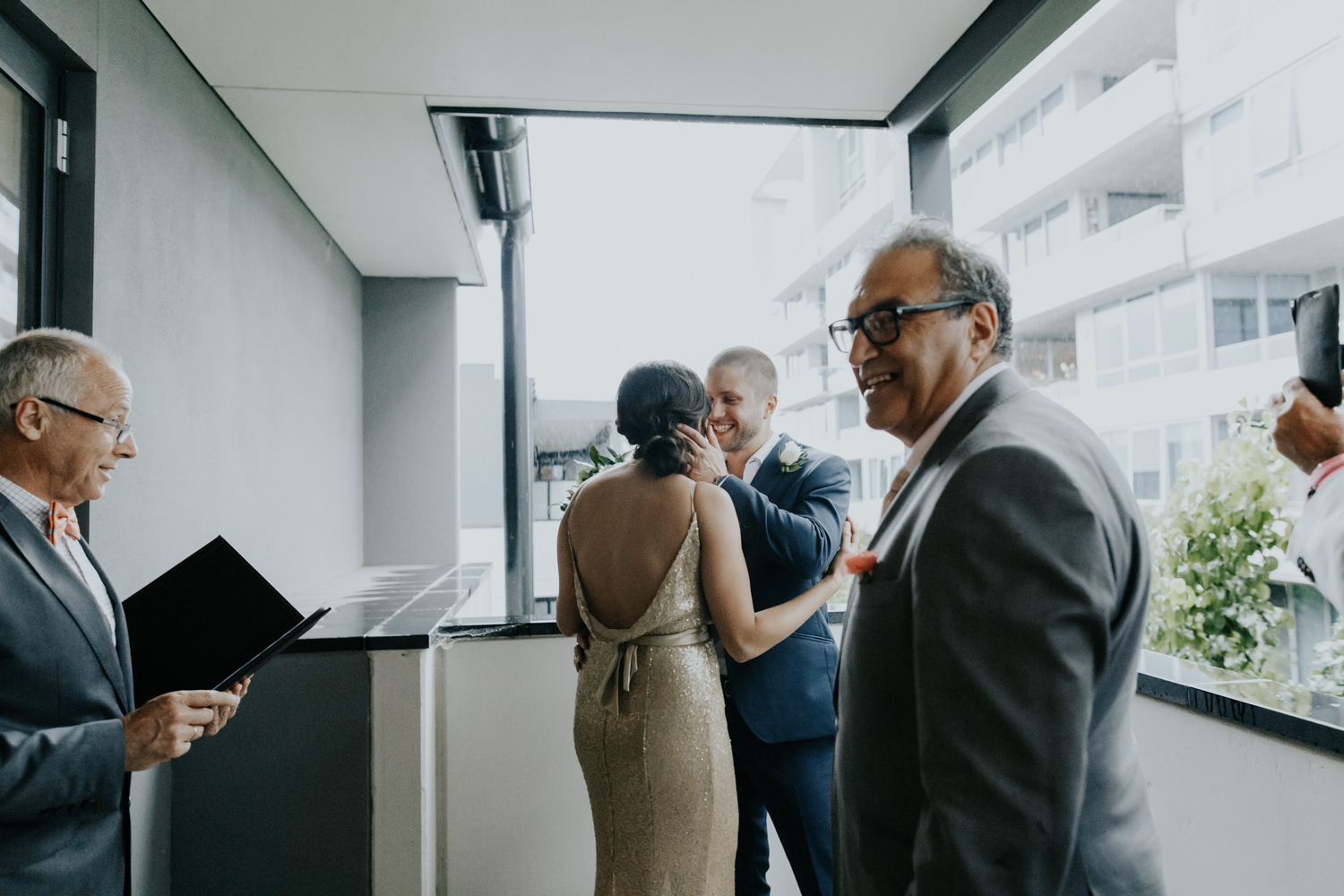 Intimate hotel room wedding Canberra - wet weather ceremony- photography by Jenny Wu