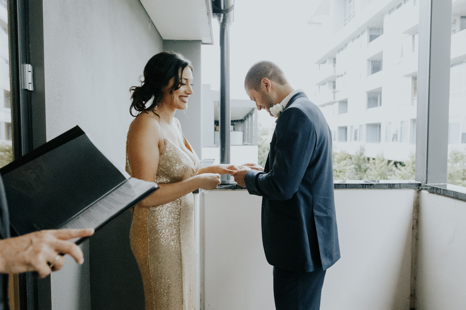 Intimate hotel balcony wedding Canberra - wet weather ceremony- photography by Jenny Wu