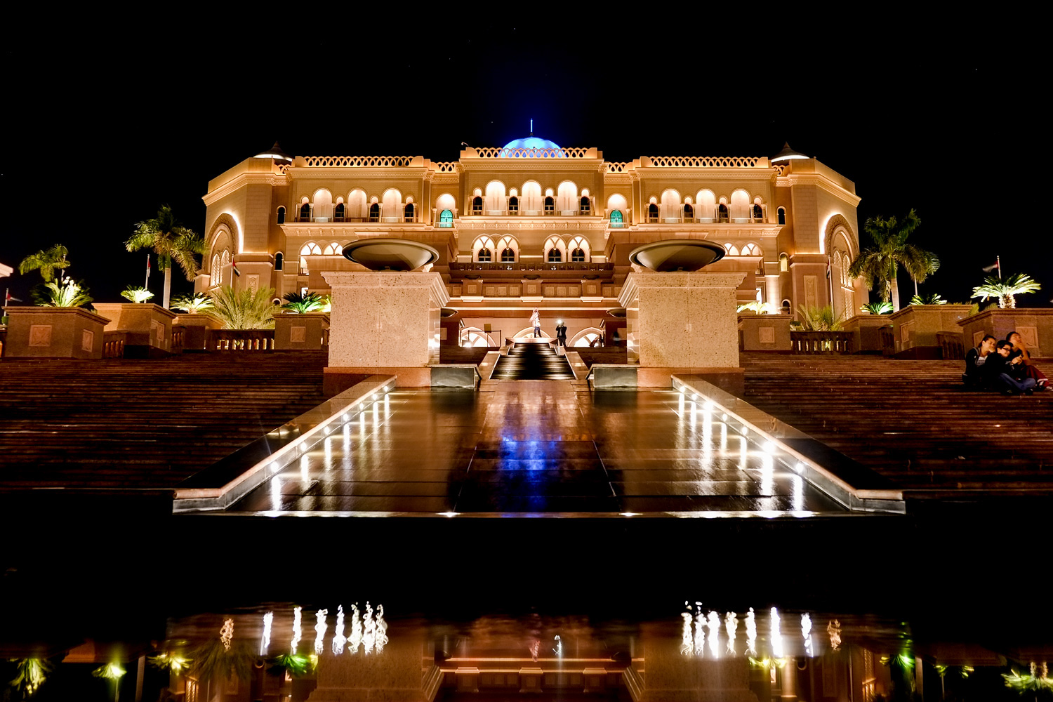Main entrance of the Emirates Palace at night, when I was leaving. Another photographer was still working, can you see him? :)