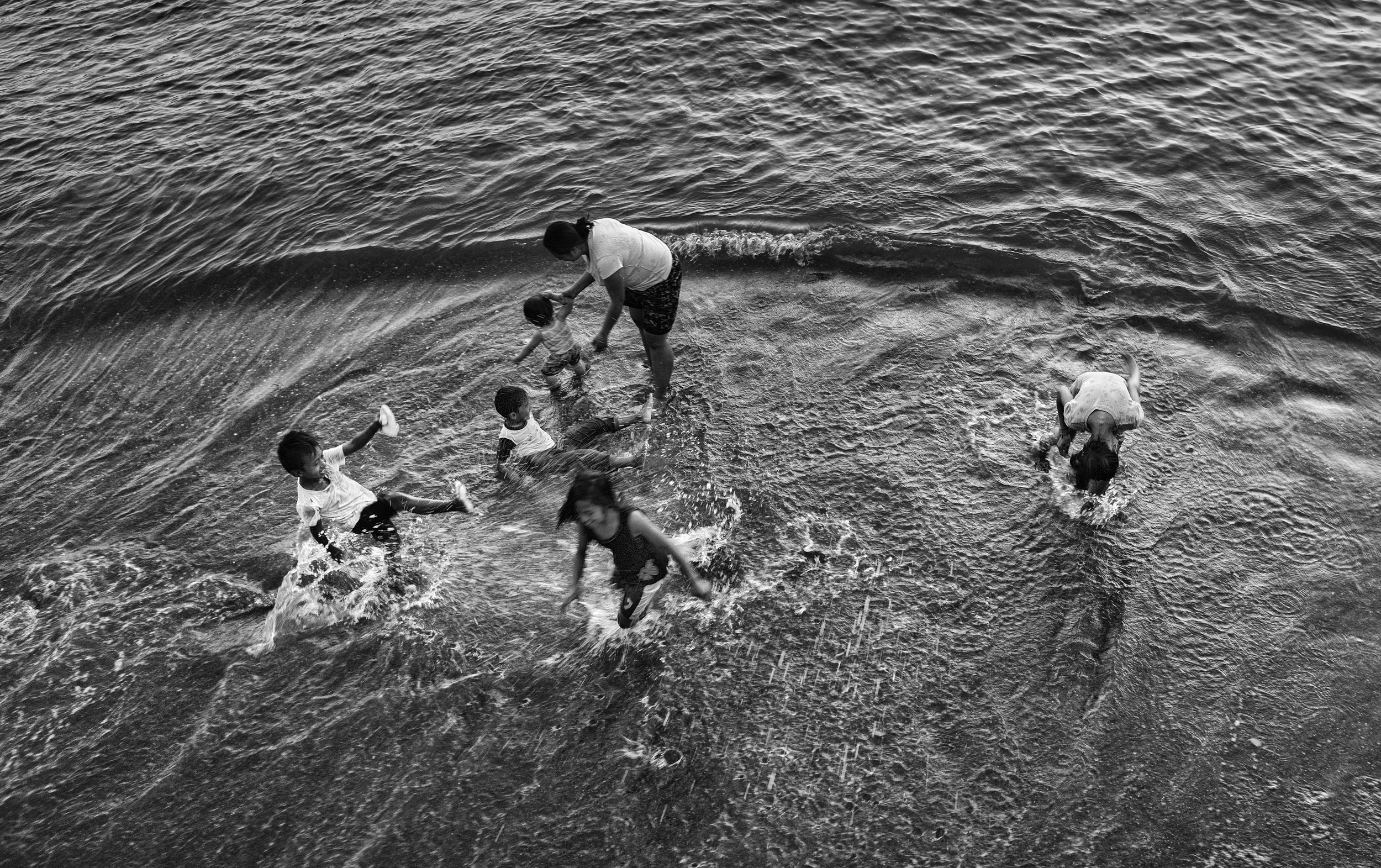 Playing in the water-cropped.jpg