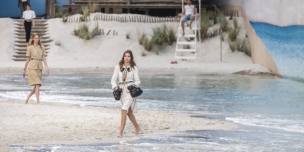 Kaia Gerber wears clothes from Chanel's Spring/Summer 2019 collection on an artificial beach inside Paris' Grand Palais.