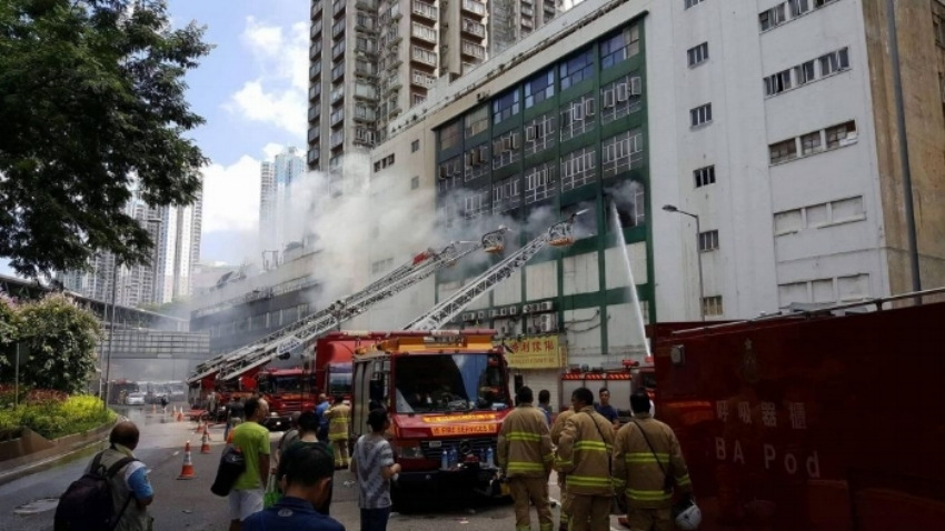 Firefighters work to put out a storage fire in hong kong.   courtesy: hong kong free press