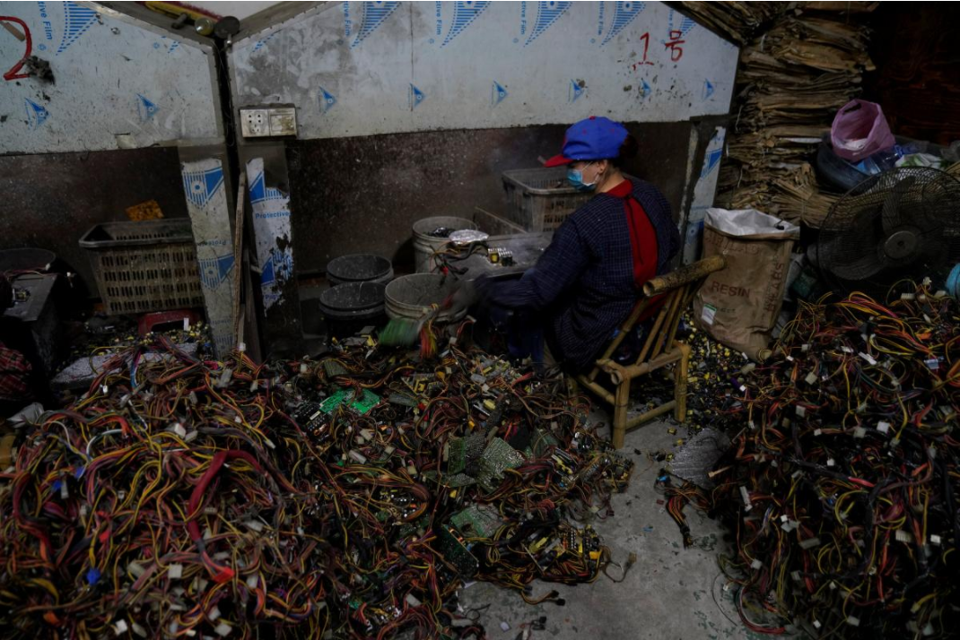 A worker dismantles electronic waste at the government-sponsored recycling park in the township of Guiyu, Guangdong Province, China January 12, 2018. Picture taken January 12, 2018.  Courtesy: REUTERS/Aly Song