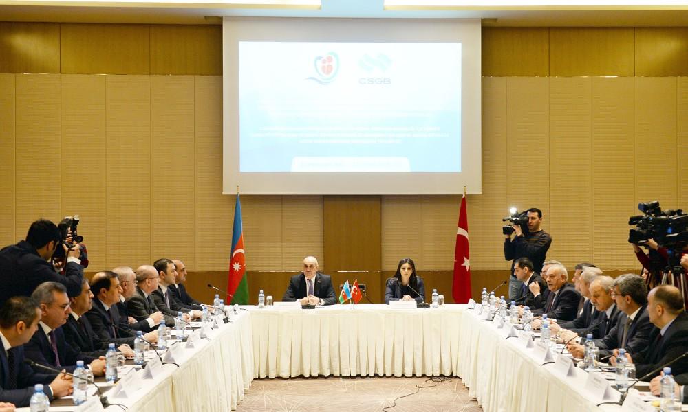 Azerbaijan's Salim Muslumov and Turkey's Julide Sarieroglu sit at the head of the table at the protocol signing ceremony in Baku, Azerbaijan on 1 February, 2018. Courtesy: Azertag