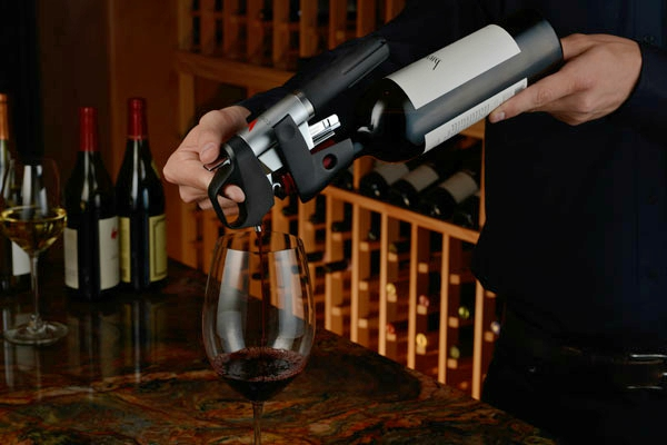 """Aptly referred to by it's creator, Greg Lambrecht, as a """"wine access system,"""" the Coravin uses a tiny needle to extract wine from a bottle while keeping the cork intact. After extraction, the system inserts a small amount of argon into the bottle ((to something about oxygen)). The cork naturally reseals, and voila! You're drinking wine from an """"unopened"""" bottle, time and time again."""