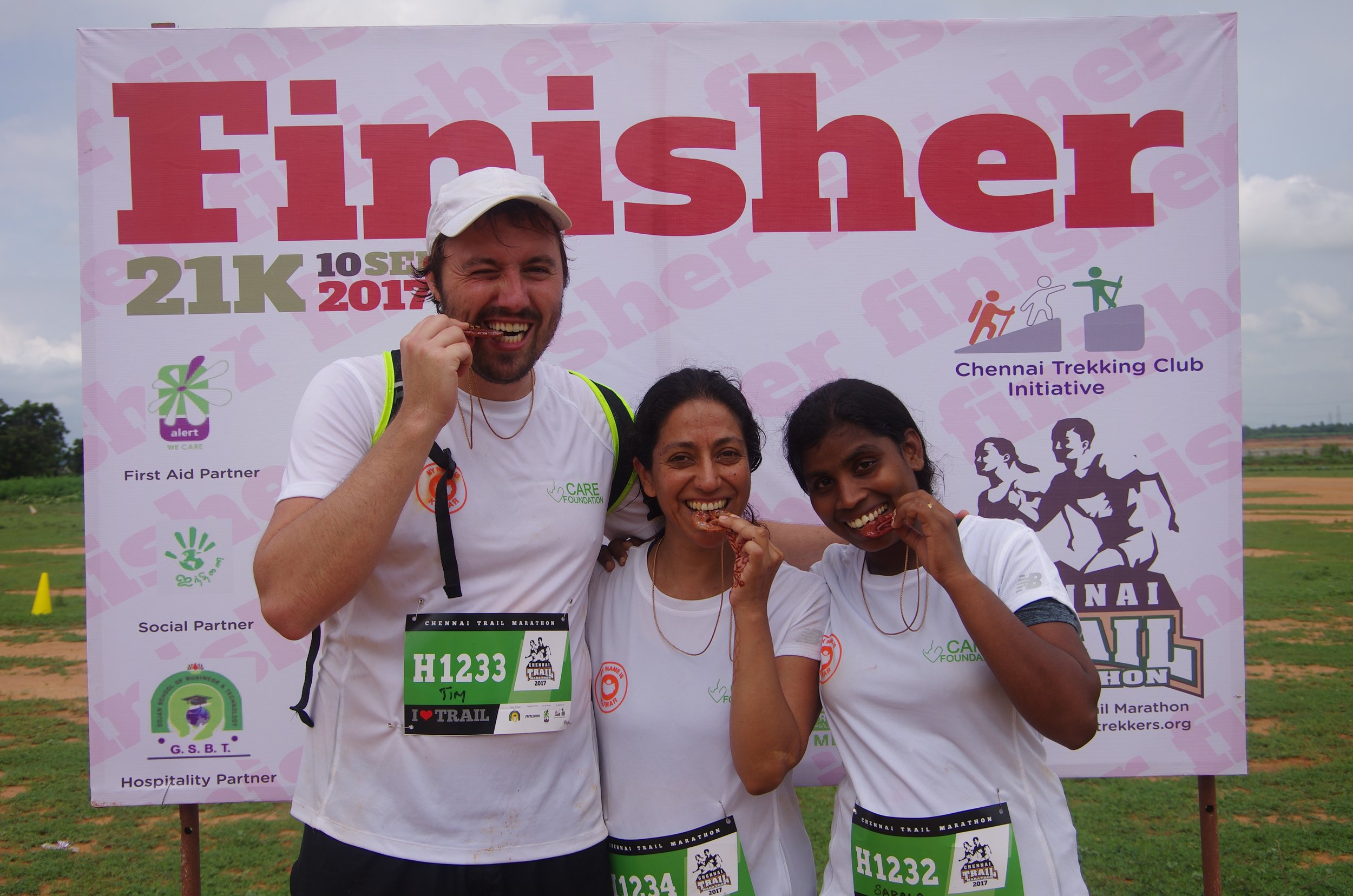 Post half marathon celebratory photo. Me (centre) with Tim (Co-founder) and Sarala (Project Manager)