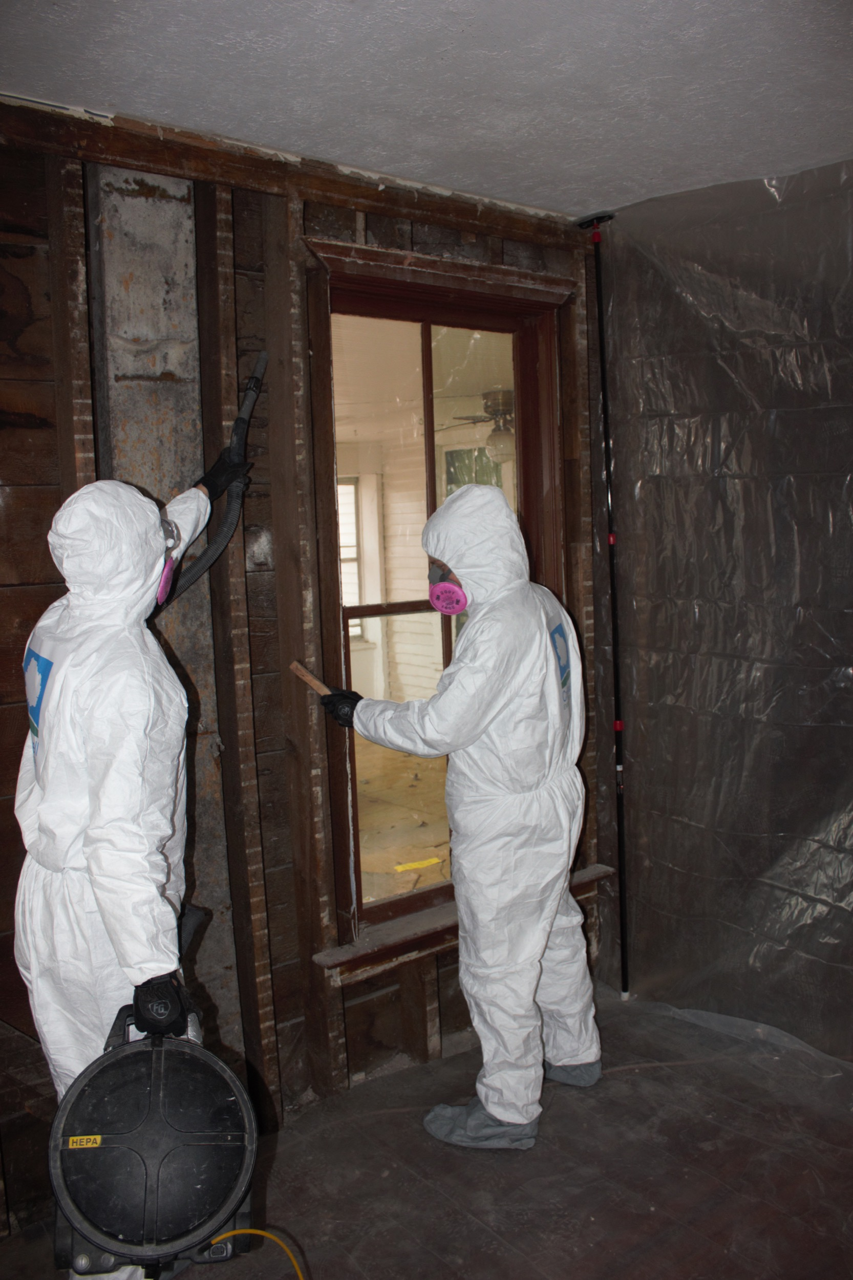 Cromwell crew members clean asbestos and lead paint in a home