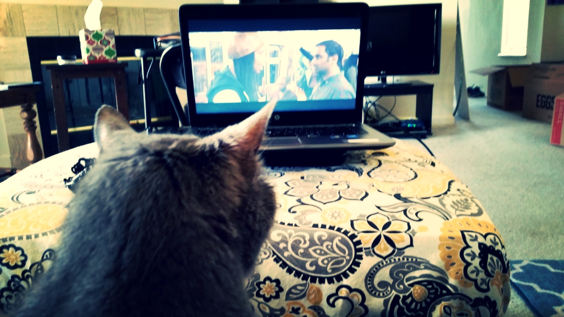 The Cat, enthralled with Aziz, who, in this scene, is enthralled with a subway masturbator.