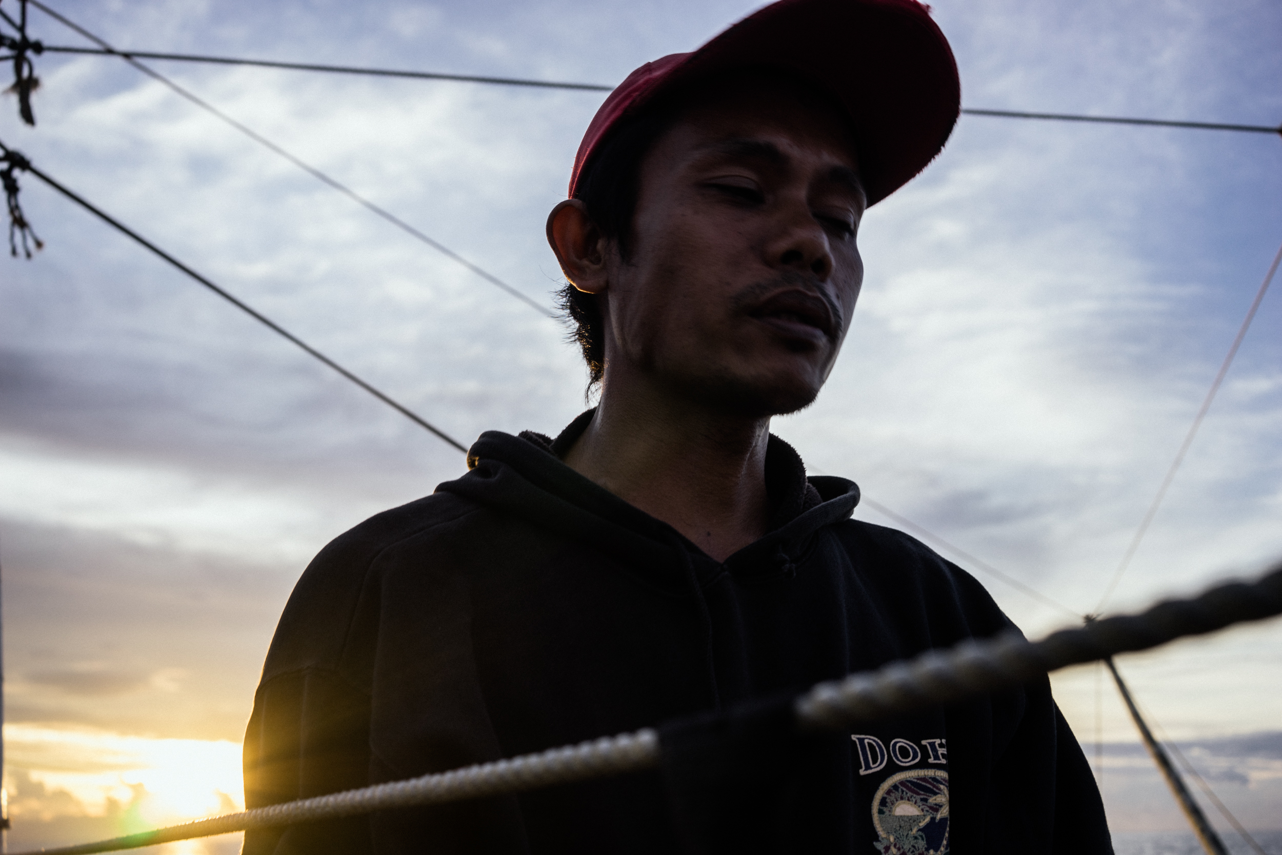 Kalibo, Philippines - September 21, 2015: Conrad Banihit, a Filipino fisherman, is seen aboard a fishing boat. Conrad is a victim of a Singapore-based maritime manning agency that collected illegal placement fees from him, stationed him on a Taiwanese fishing vessel where he faced inhumane circumstances, and then failed to give him the salary he was promised. Today he has gotten out of the ship, and makes approximately 35 USD a month at a local fishing boat. Hannah Reyes