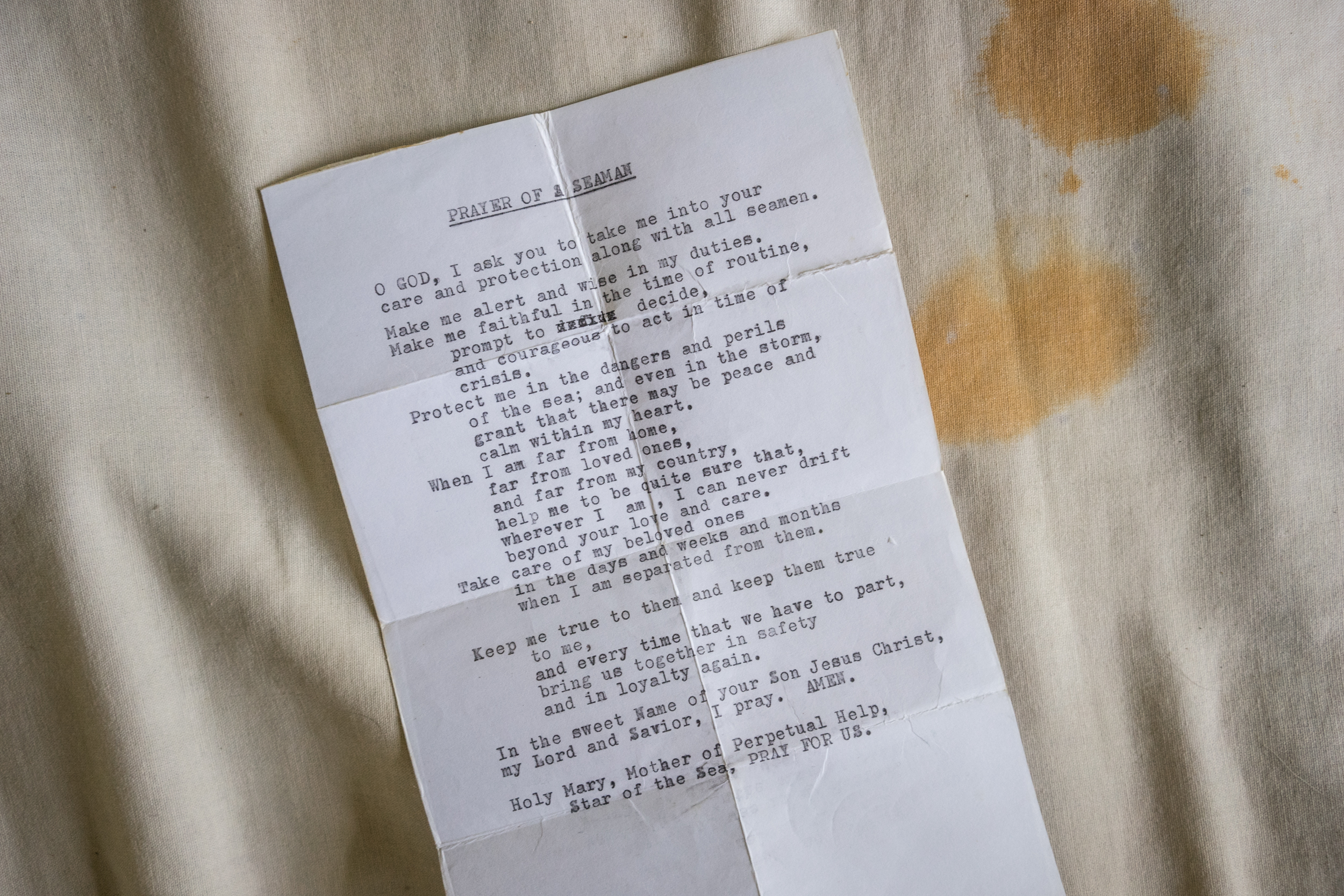Kalibo, Philippines - September 20, 2015: A slip of paper with a typewritten prayer for seafarers is seen in the home of Reden Remorate. Remorate is one of the victims of a Singapore based  maritime manning agency whose recruits are vulnerable to abuse both at sea and on land. Hannah Reyes