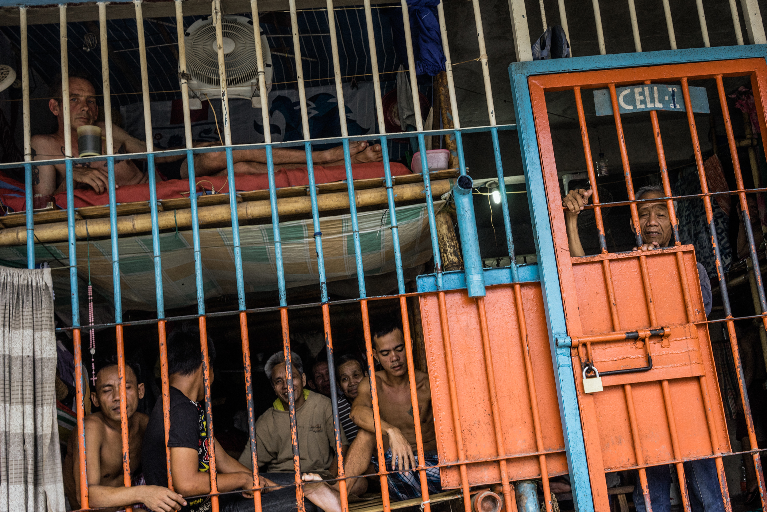 Kalibo, Philippines - September 20, 2015: Inmates at the local jail, where Celia Robelo, a Filipina woman, is being held for human trafficking and illegal recruitment charges following the death of a Filipino seafarer. Robelo claims that she did not have any knowledge of the illegal nature of her recruitment, claiming she only wanted to help these men find work and a way out of poverty. Hannah Reyes