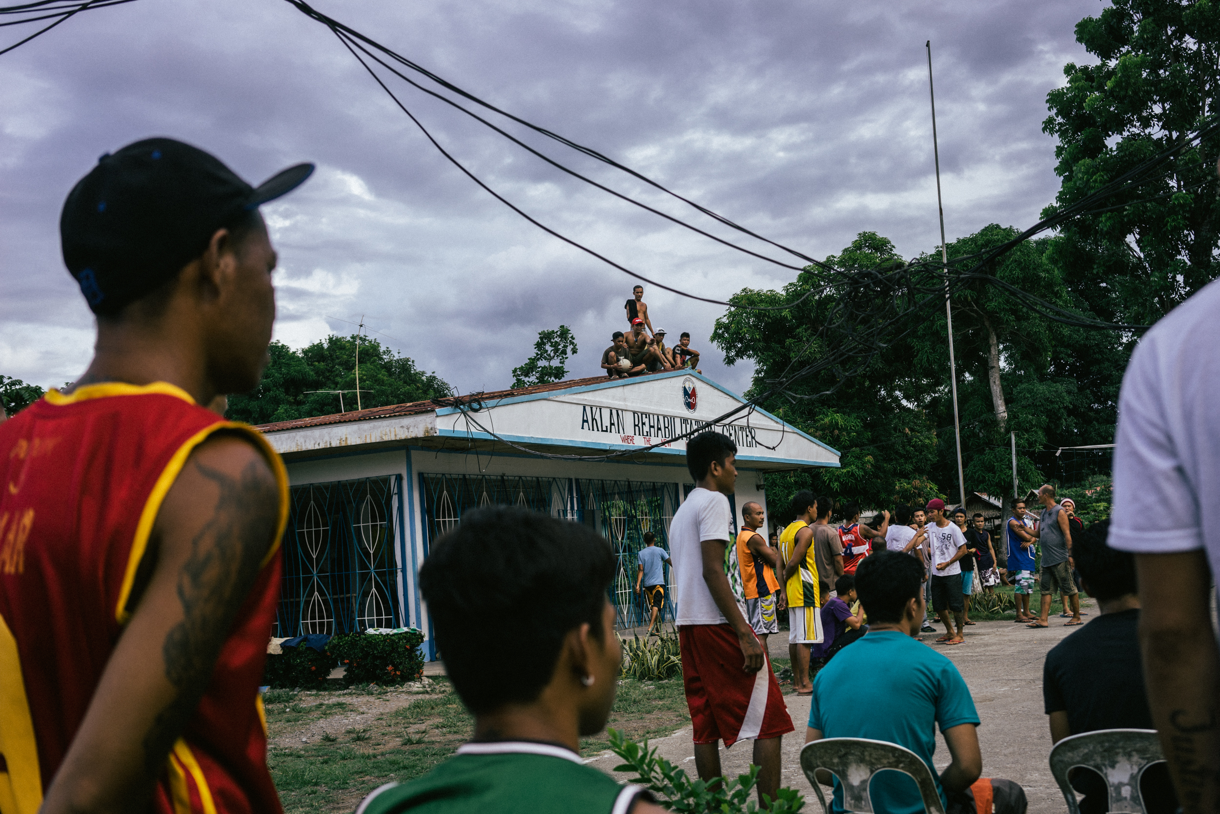 Kalibo, Philippines - September 20, 2015: Men are seen at a local jail. The jail is now home to Celia Robelo, who is being charged for human trafficking and illegal recruitment, following the death of a Filipino seafarer. Robelo claims that she did not have any knowledge of the illegal nature of her recruitment, claiming she only wanted to help these men find work and a way out of poverty. Hannah Reyes