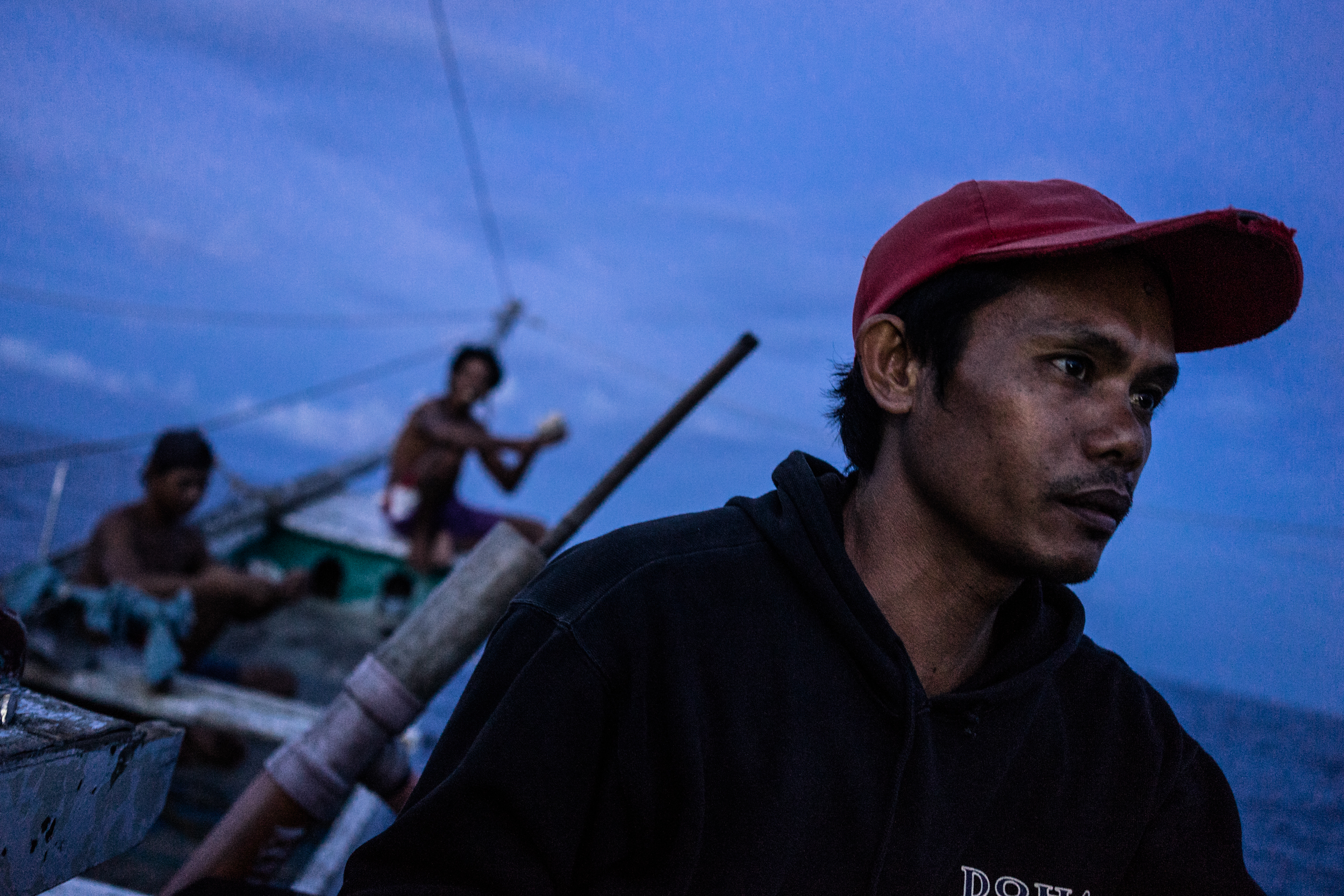 Kalibo, Philippines - September 21, 2015: Conrad Banihit is seen in a local fishing boat in Kalibo, Philippines. Because of the low wage he earns, Conrad decided to go aboard a Taiwanese fishing vessel, to which he was illegally recruited, then abused on board, and was not paid the salary he was promised. Hannah Reyes