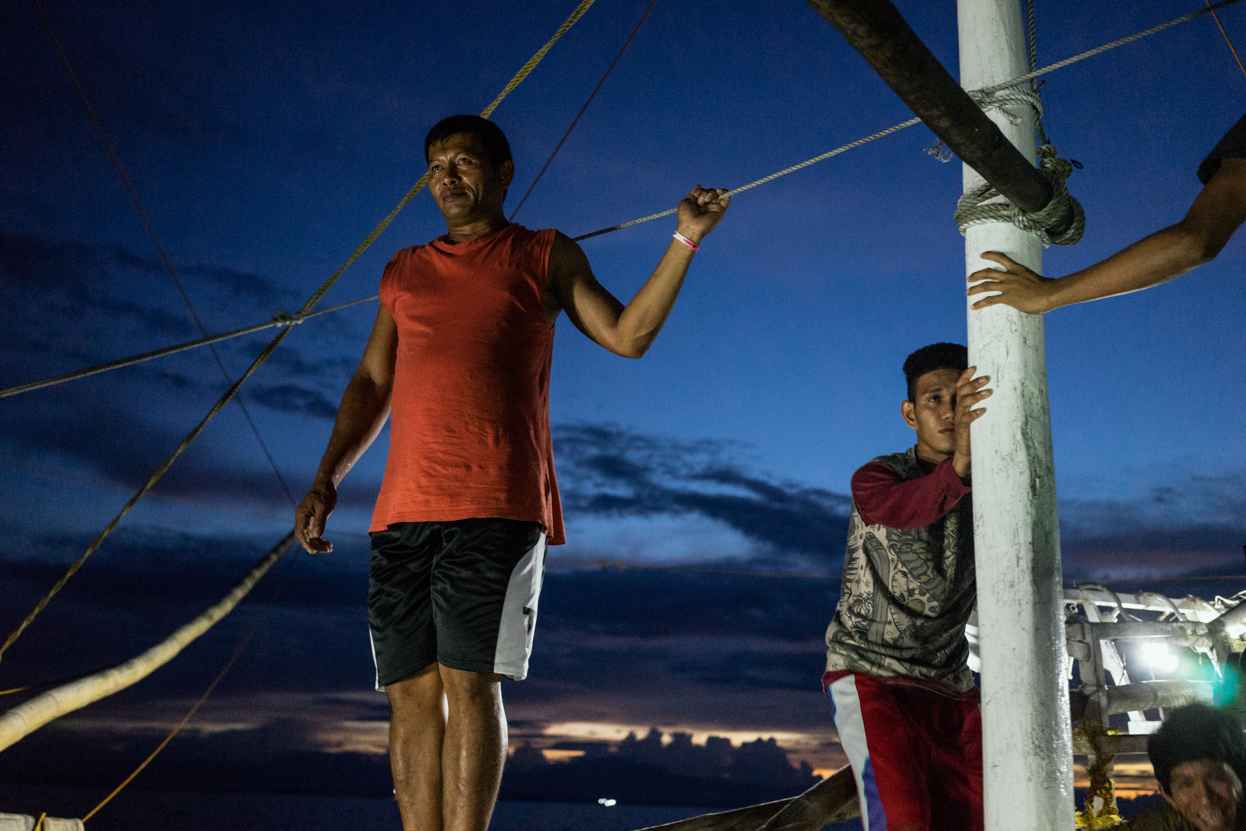 Kalibo, Philippines - September 21, 2015: The captain of a local fishing boat is seen at work. Members of the crew, who make approximately 35 USD per month, have expressed their desire to work on a larger fishing vessel for the promise of a higher income despite stories of fellow fishermen about the forms of abuse that happen on such vessels. Hannah Reyes
