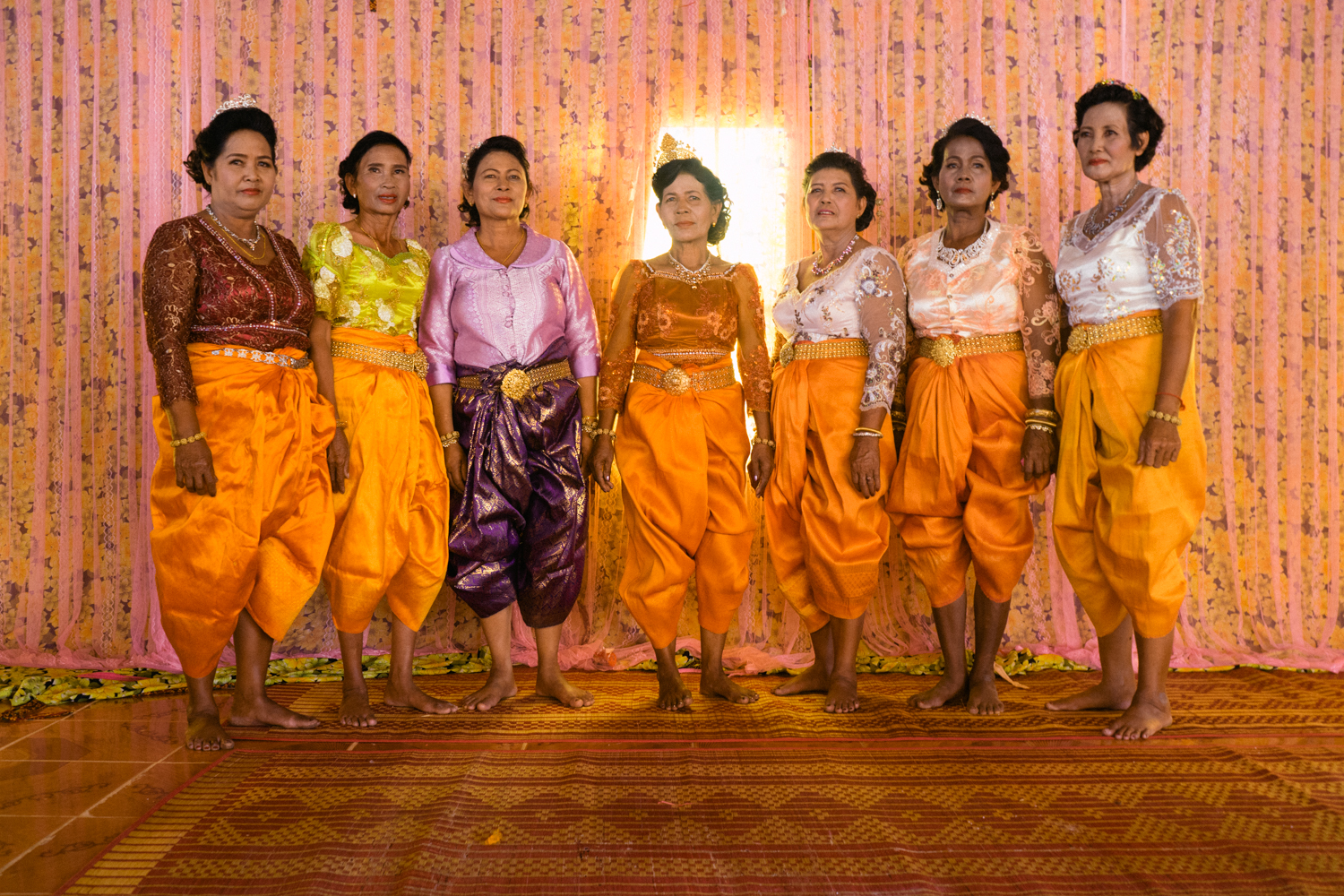 Brides pose for a photo at a ceremony held for victims of forced marriages by the Khmer Rouge. Several couples in a Cambodian commune have decided to have a formal wedding ceremony almost four decades after their forced marriage, a crime which is today being tried as a crime against humanity by a war crimes tribunal.