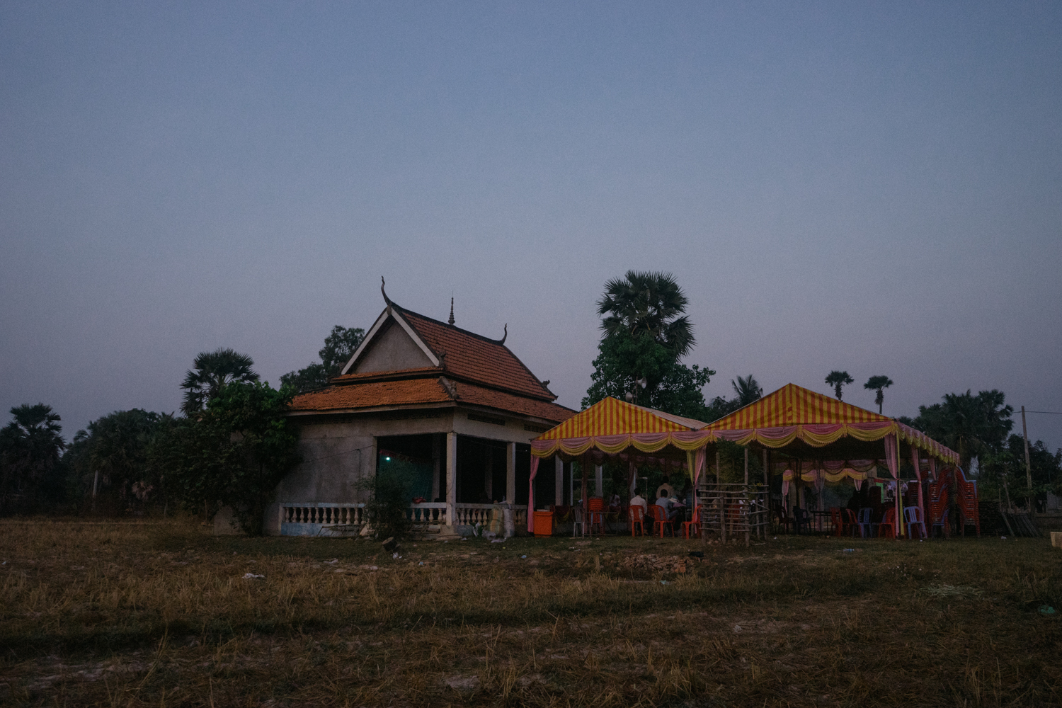 Tents are set up at dawn for a ceremony held for victims of forced marriages by the Khmer Rouge. Several couples have decided to have a formal wedding ceremony almost four decades after their forced marriage, a crime which is today being tried as a crime against humanity by a war crimes tribunal.