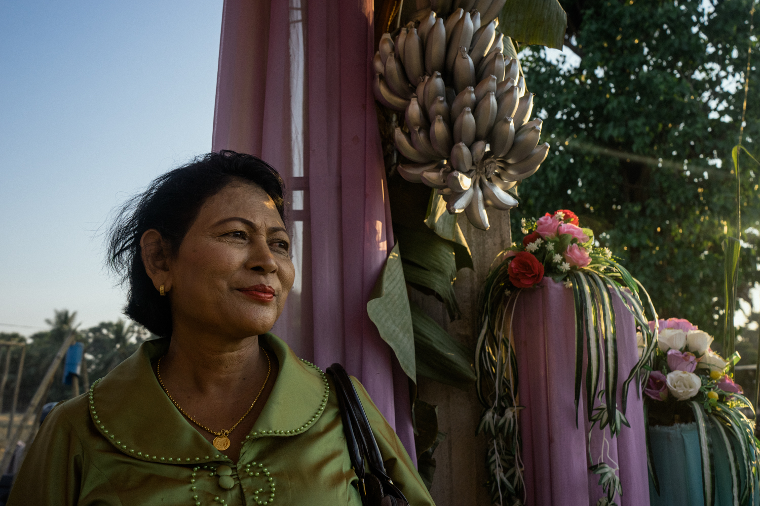 Kae Khan, a Cambodian bride, waits to greet her guests at a wedding ceremony held for victims of forced marriages by the Khmer Rouge. Several couples have decided to have a formal wedding ceremony almost four decades after their forced marriage, a crime which is today being tried as a crime against humanity by a war crimes tribunal.