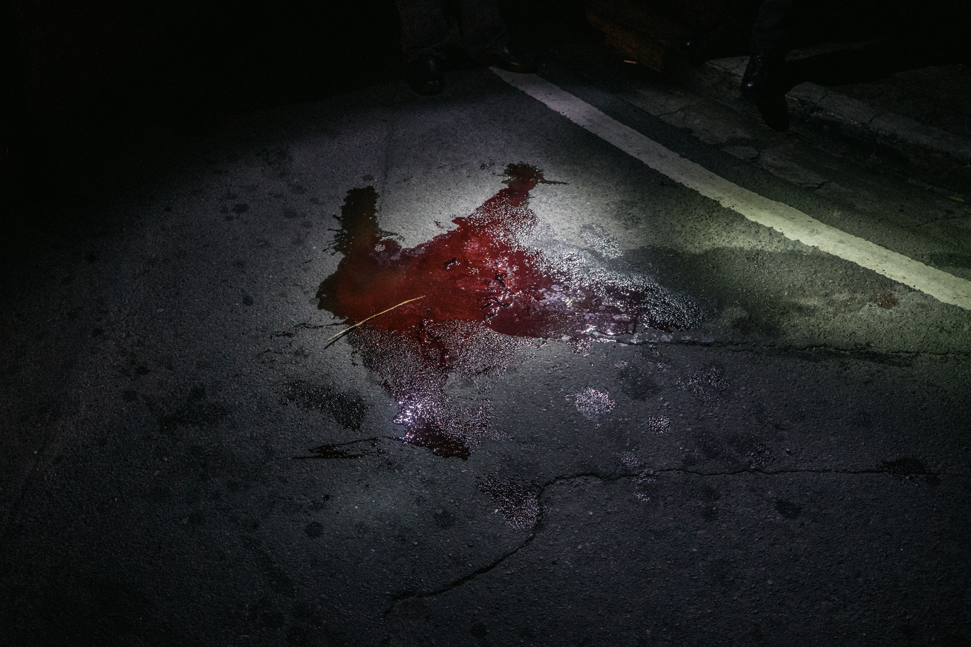 Blood from a gun shot is seen on the streets of Metro Manila.