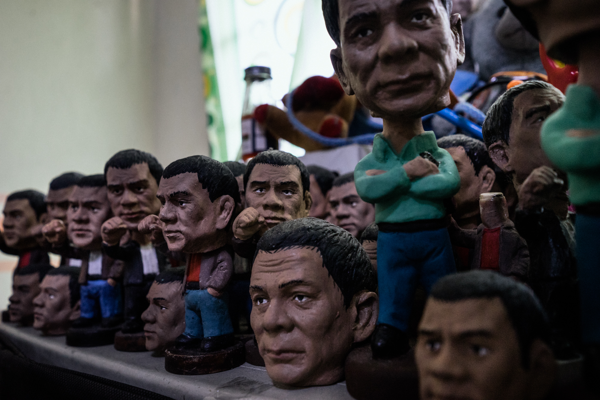 'Bobble Head' dolls of President Rodrigo Duterte are seen in the home of a supporter.