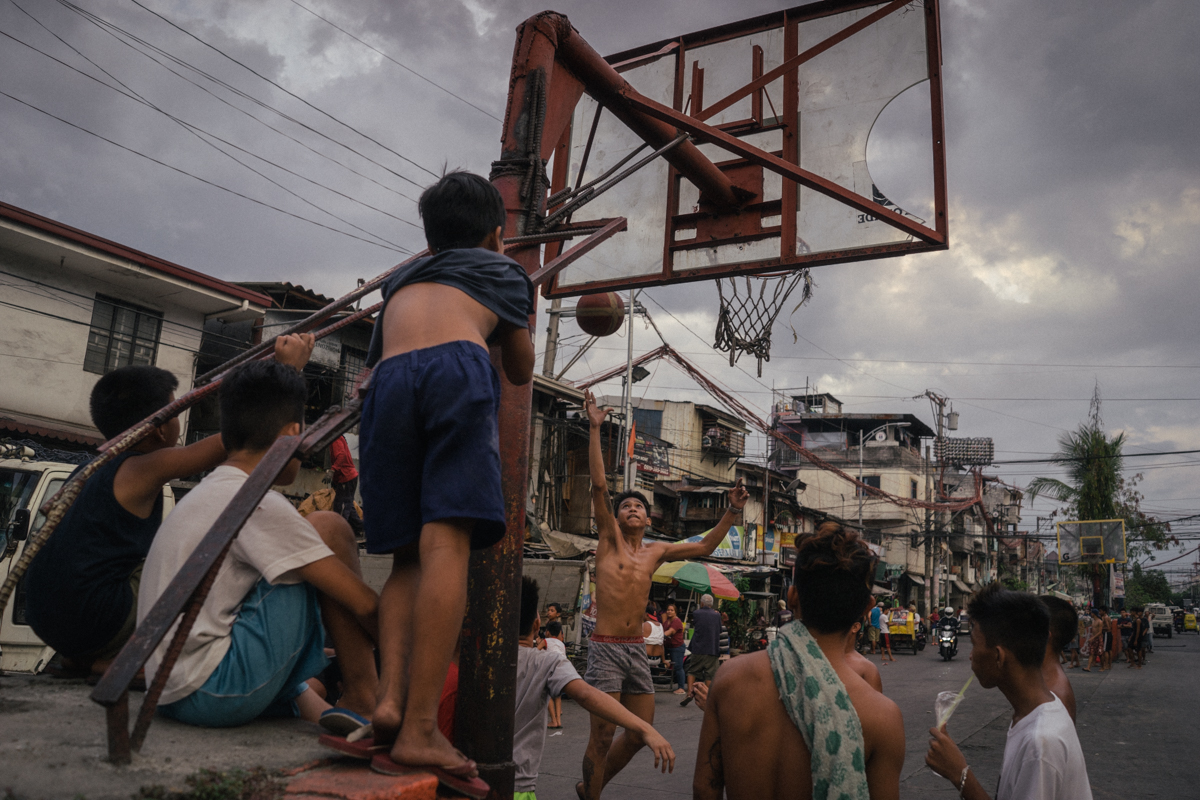People are seen in a slum community where many residents expressed support for Rodrigo Duterte despite killings in their neighborhood. Duterte has been widely criticized by international human rights organizations for his 'War on Drugs' which has taken thousands of lives since he took office, but his approval rating remains positive among the majority of Filipinos, especially the poor and the working class.