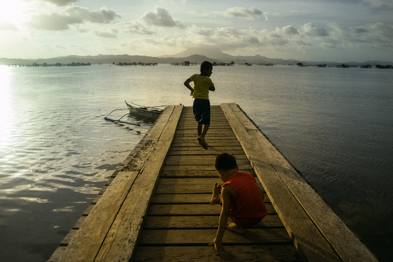 Children play in a jetty in Malampaya Sound, a marine protected area in Palawan, Philippines. Palawan is part of the Coral Triangle, the global centre of marine biodiversity, and a global priority for conservation. Over 120 million people live in the Coral Triangle, relying on it for their shelter, sustenance, and livelihood.