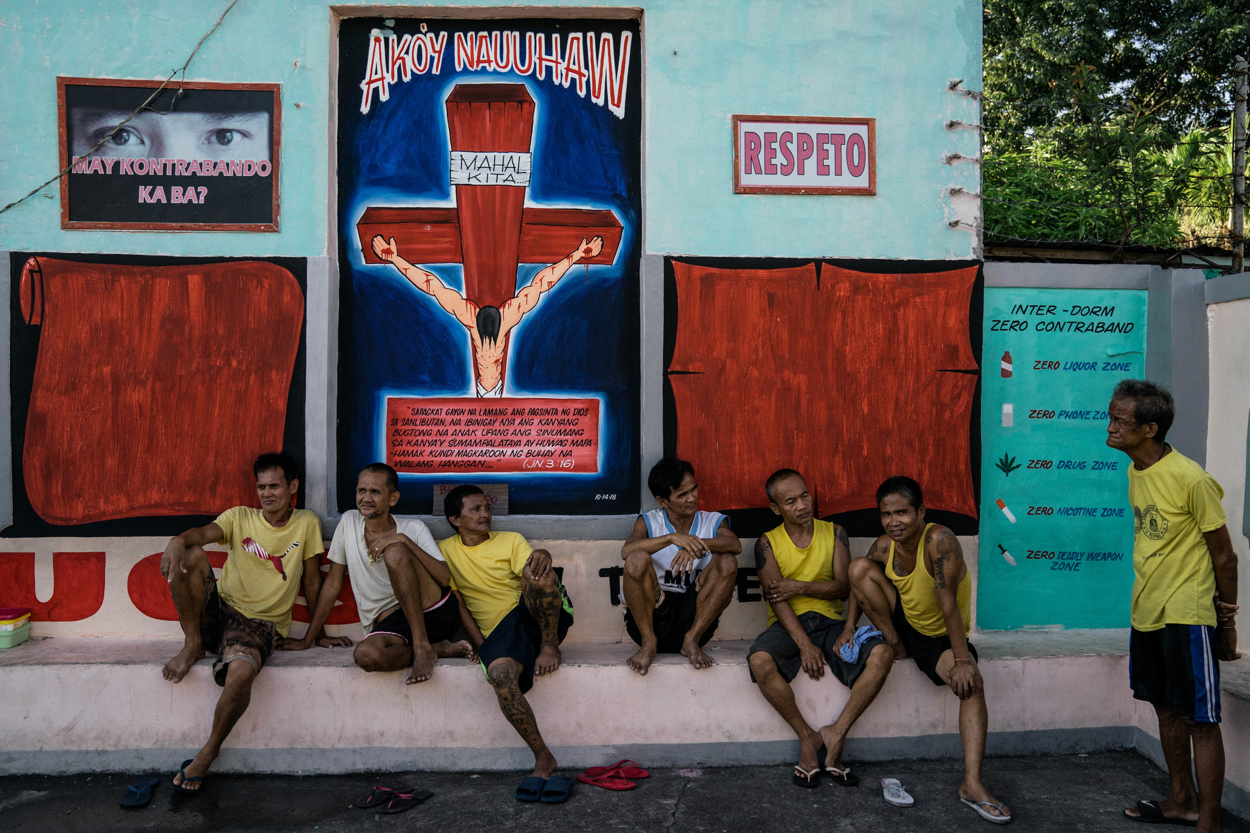 Men hang out by paintings depicting Jesus and contrabands in the Manila City Jail in Manila, Philippines on October 31, 2018. In the Philippines, men with pending cases spend months, sometimes years, in overcrowded cells waiting to be charged, sentenced, or tried.