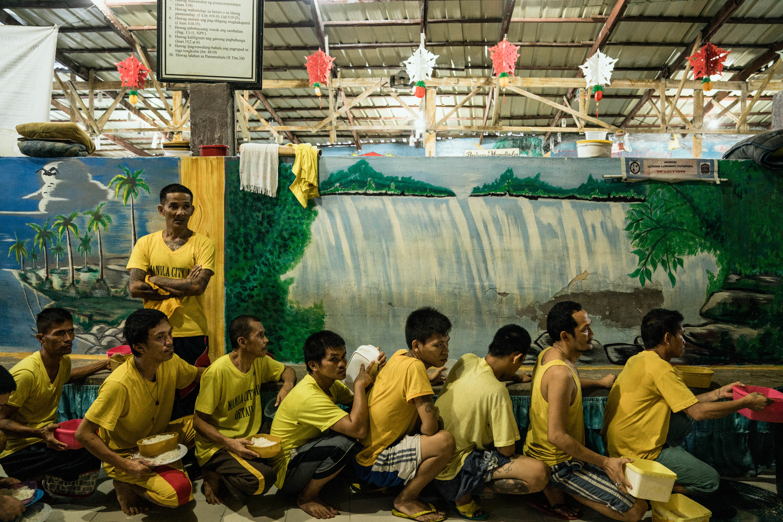 Men line up for food in the Manila City Jail in Manila, Philippines on October 31, 2018. In the Philippines, men with pending cases spend months, sometimes years, in overcrowded cells waiting to be charged, sentenced, or tried.
