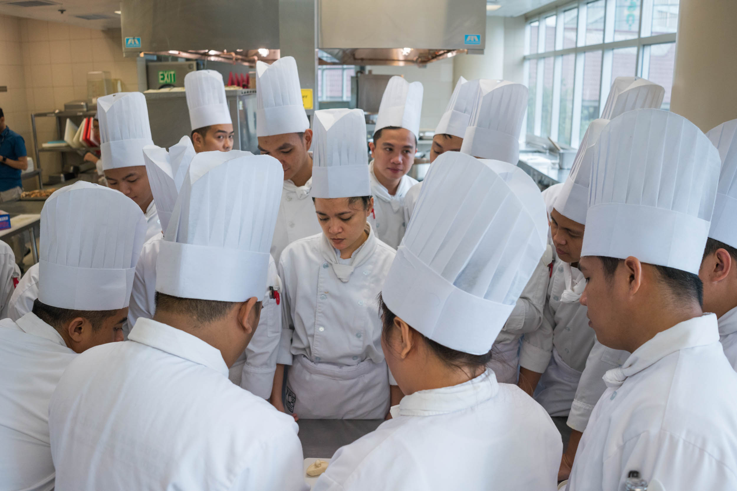 For decades the Philippine government has facilitated migration abroad as a way to develop the country. A sprawling trade school industry helps give Filipinos needed skills. Chefs prepare for jobs in hotels and restaurants.