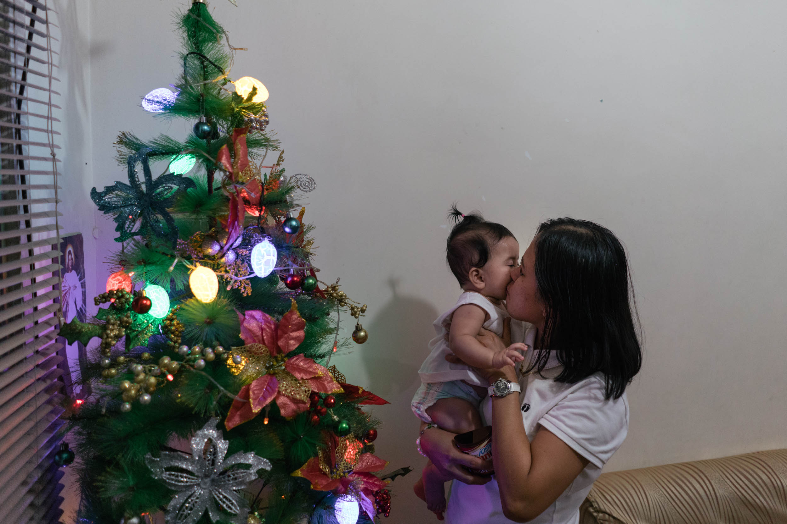 Sheila, a domestic worker from Hong Kong, arrives in her home in Cavite, South of Manila, where her relatives greet her.