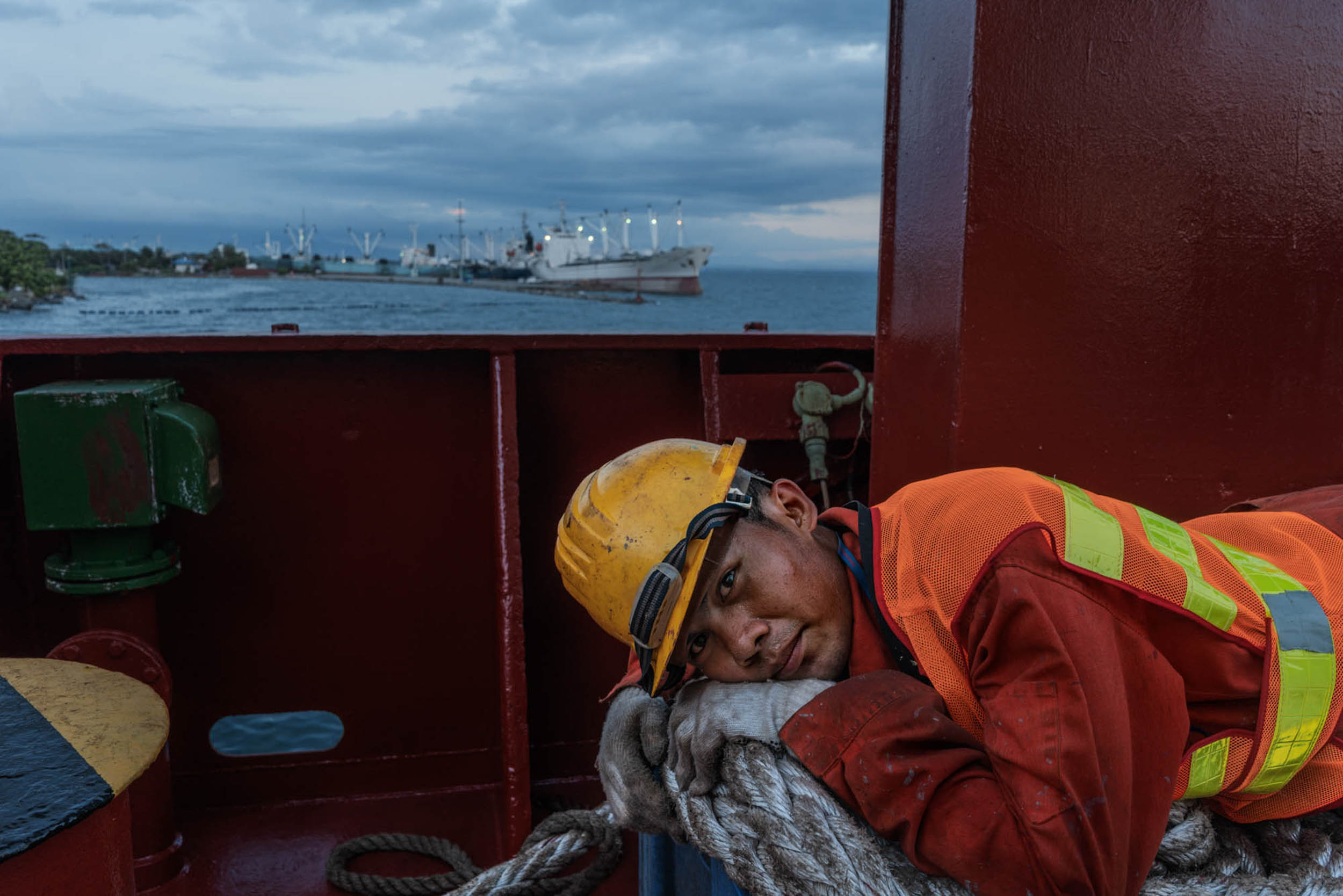 Photo by @hannahreyesmorales. Ian Pineda, a merchant sailor, lies on a spool of rope on the deck of a cargo ship. Filipino seafarers are explorers in their own right: they've explored the world's seas. Seasoned seafarers have endless stories spanning oceans and ports across dozens of countries. But they all tell a common tale: of missing home, the Philippines. It is estimated that at least 1 in 4 of the world's mariners are Filipino.