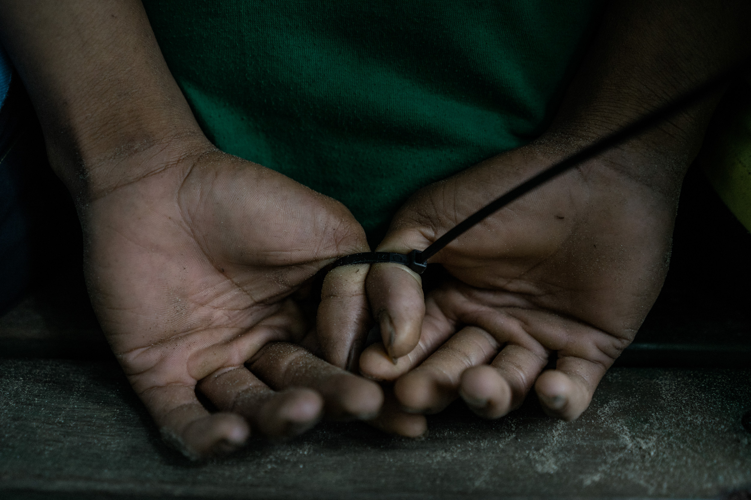 Hands of a man are seen tied up after his arrest. The man is part of a group suspected of dealing drugs and supplying the ISIS inspired Bangsamoro Islamic Freedom Fighters with weaponry. He was arrested in an operation by a Philippine Army battalion serving in Mindanao, South of the Philippines, and home to the second oldest internal conflict in the world. Mindanao is currently under military rule, or martial law, due to the siege in Marawi and the rise of insurgents pledging to ISIS.